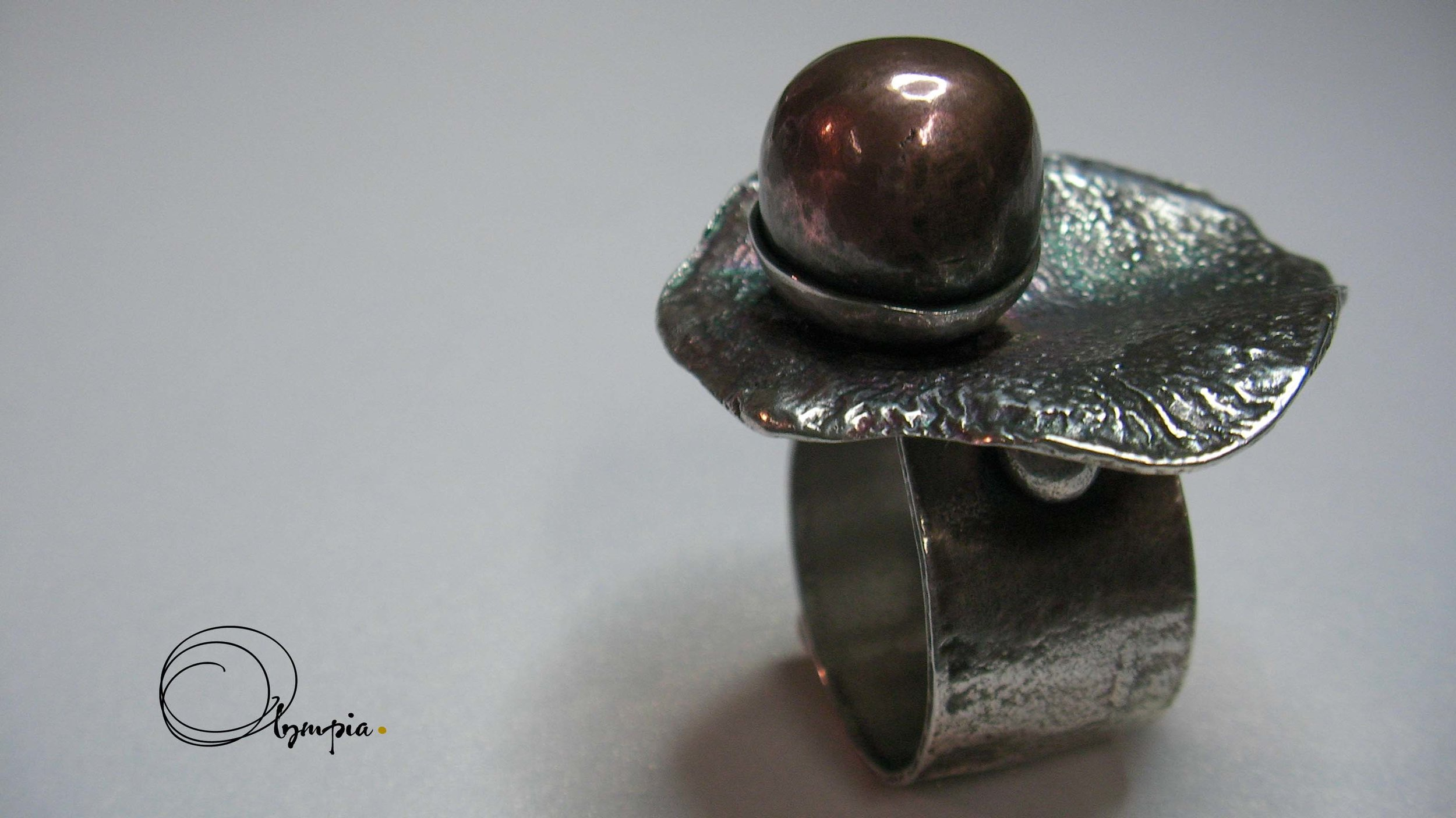 reticulated ring with copper ball.jpg