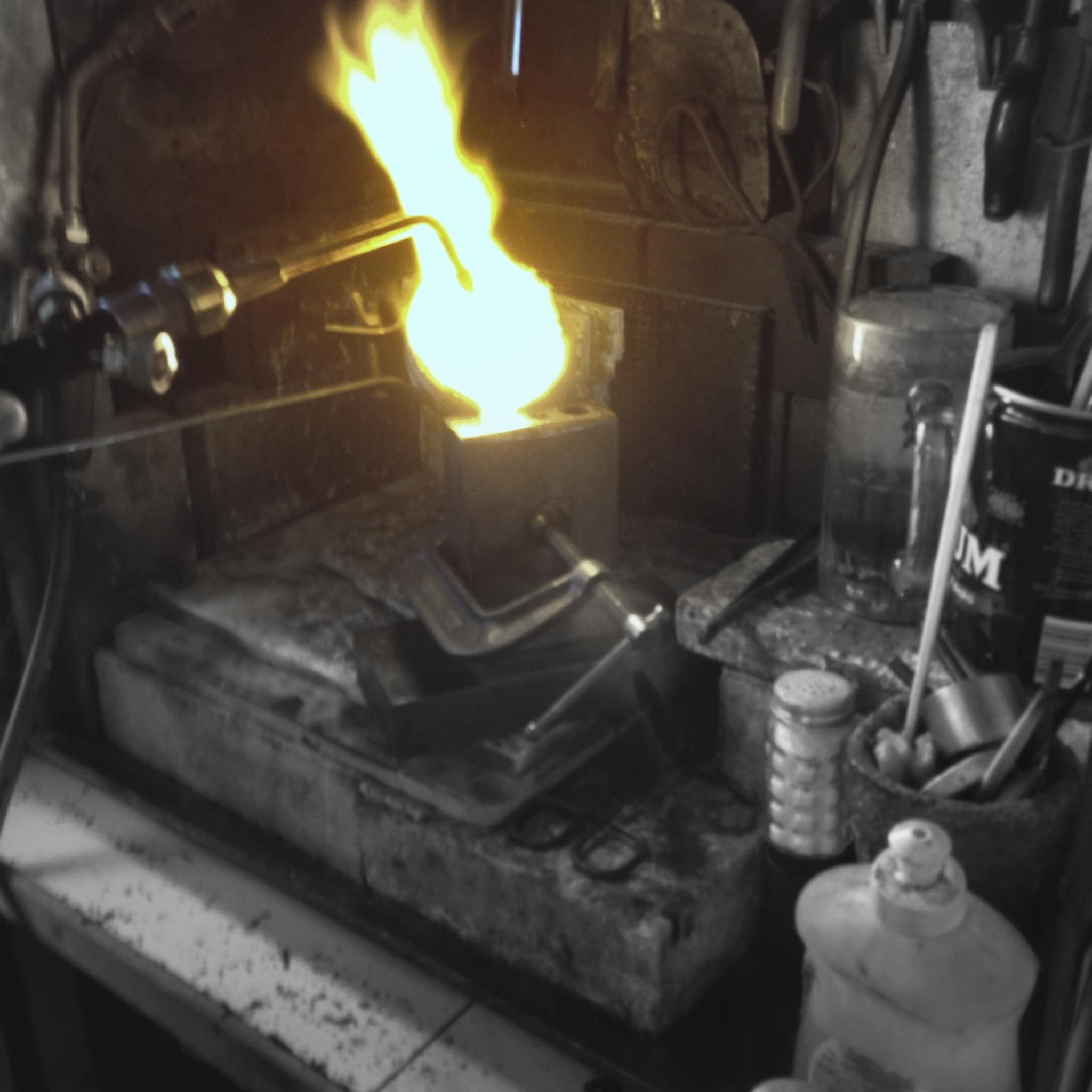 molten silver poured into the ingot device