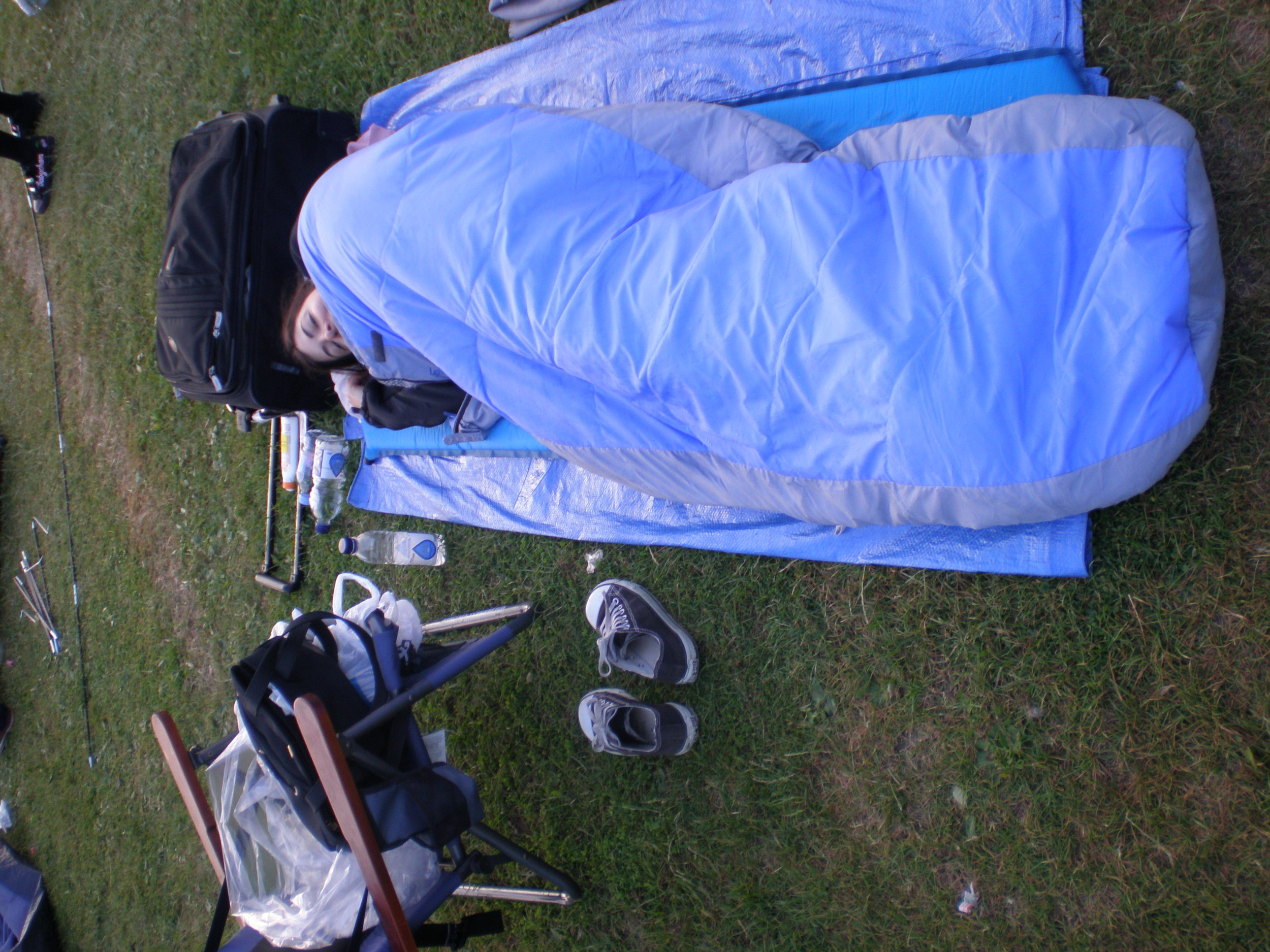 Me in my sleeping bag, queuing without a tent