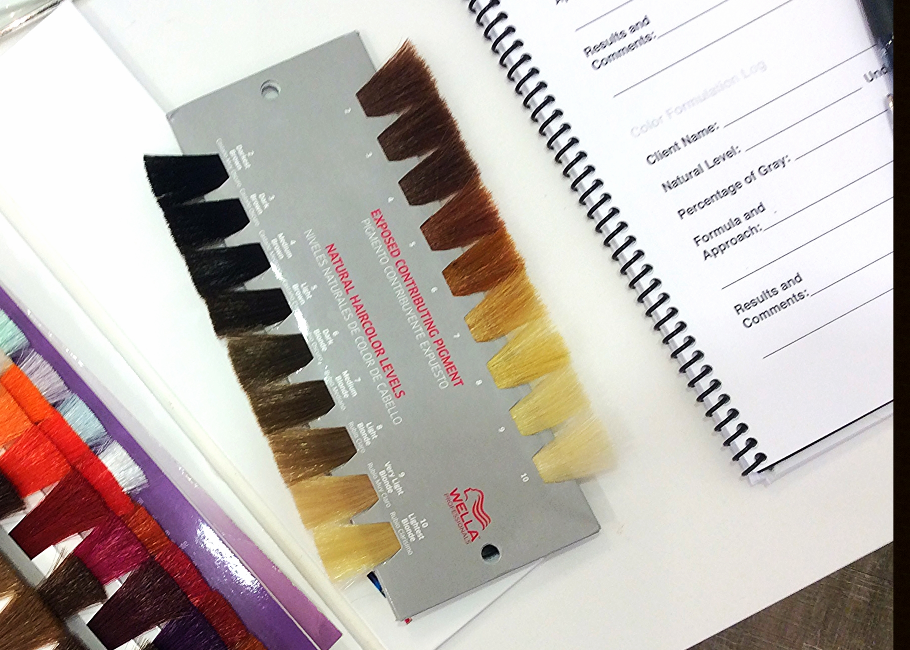 (The colors on the left of this swatch show natural levels of hair. The right is the exposed underlying pigment in hair that each level lifts to. After lightening the natural color to the desired level of lightness, an appropriate toner is used!)