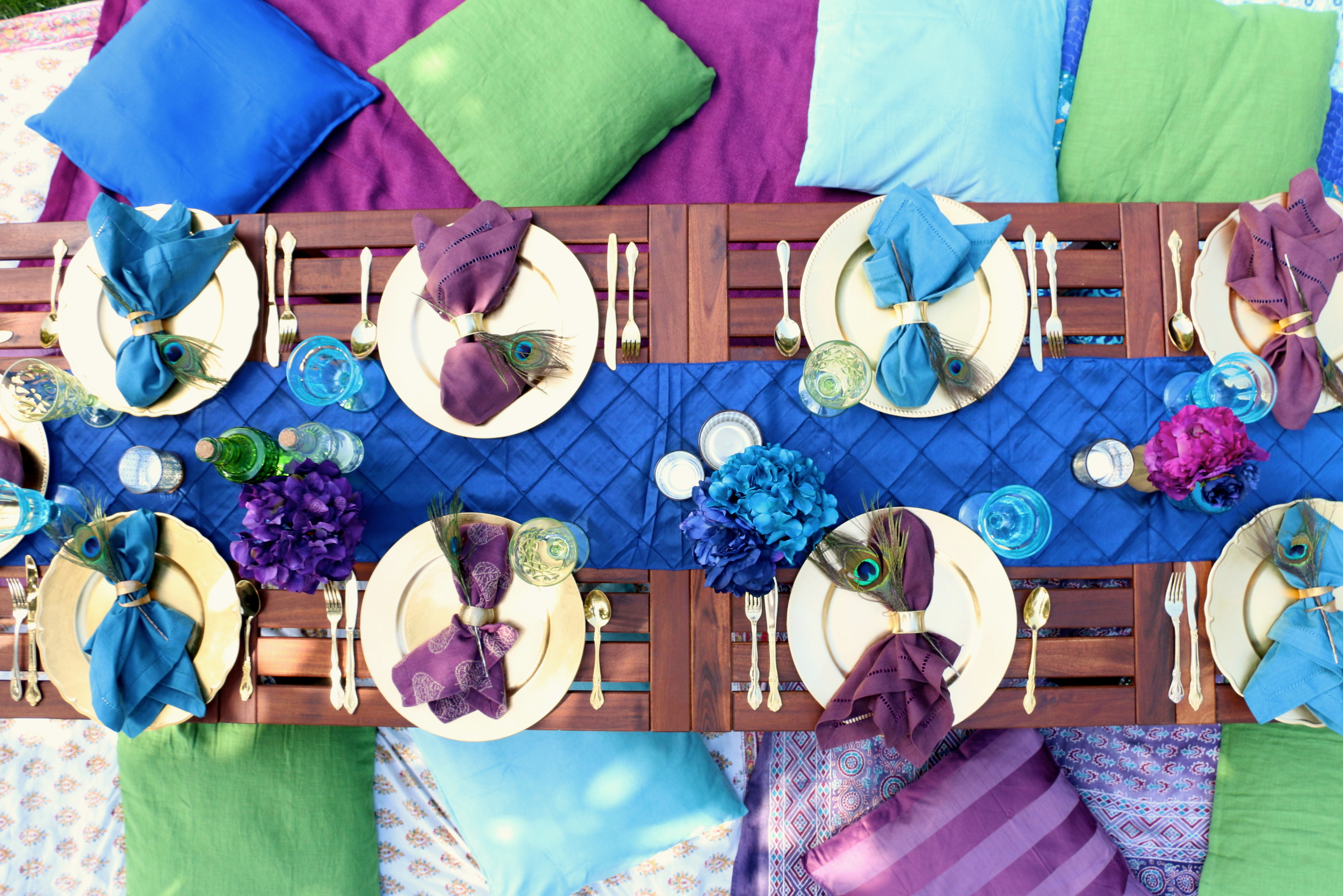 Royal Purples, blues, & emerald greens. The Peacock Goddess Party is a divine collection that is prepackaged and ready to rent from @inJOYtheParty!
