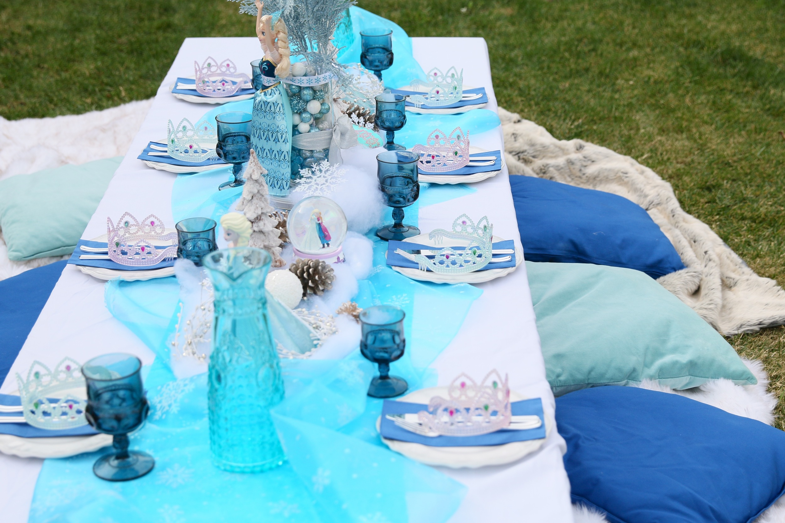 Table linens, faux fur blankets, & pillows! FROZEN PARTY @inJOYtheParty