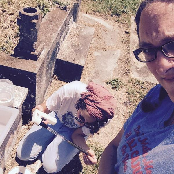 Dr. RC Christofferson looking for mosquitoes in a graveyard with her graduate student