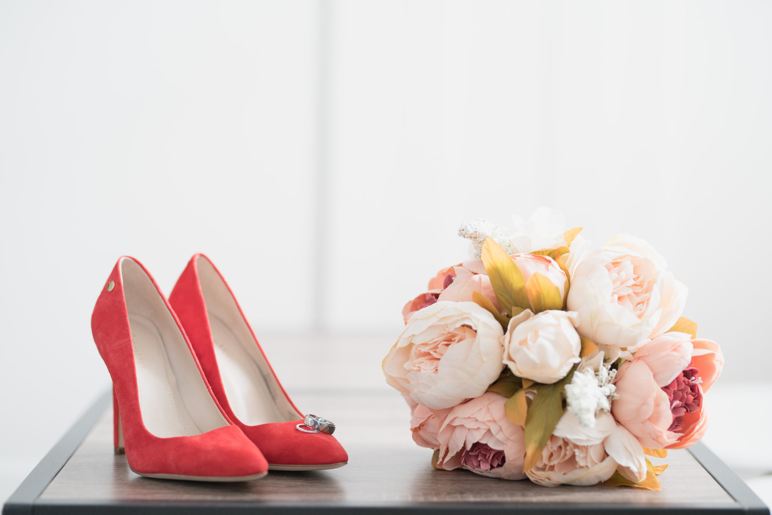 As the Bride and Groom continued to get ready, we had the opportunity to capture the important little details. Anh chose beautiful red stilettos to compliment her grecian styled A-line off the shoulder chiffon wedding gown. The simple touch of pink captured in her bouquet of peonies was an added plus.