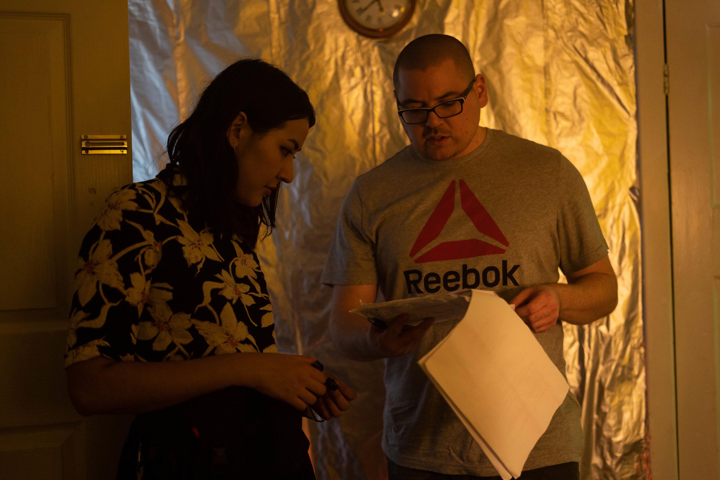 Art Director Christina Cushing talks on set with writer-director Matthew B.C.