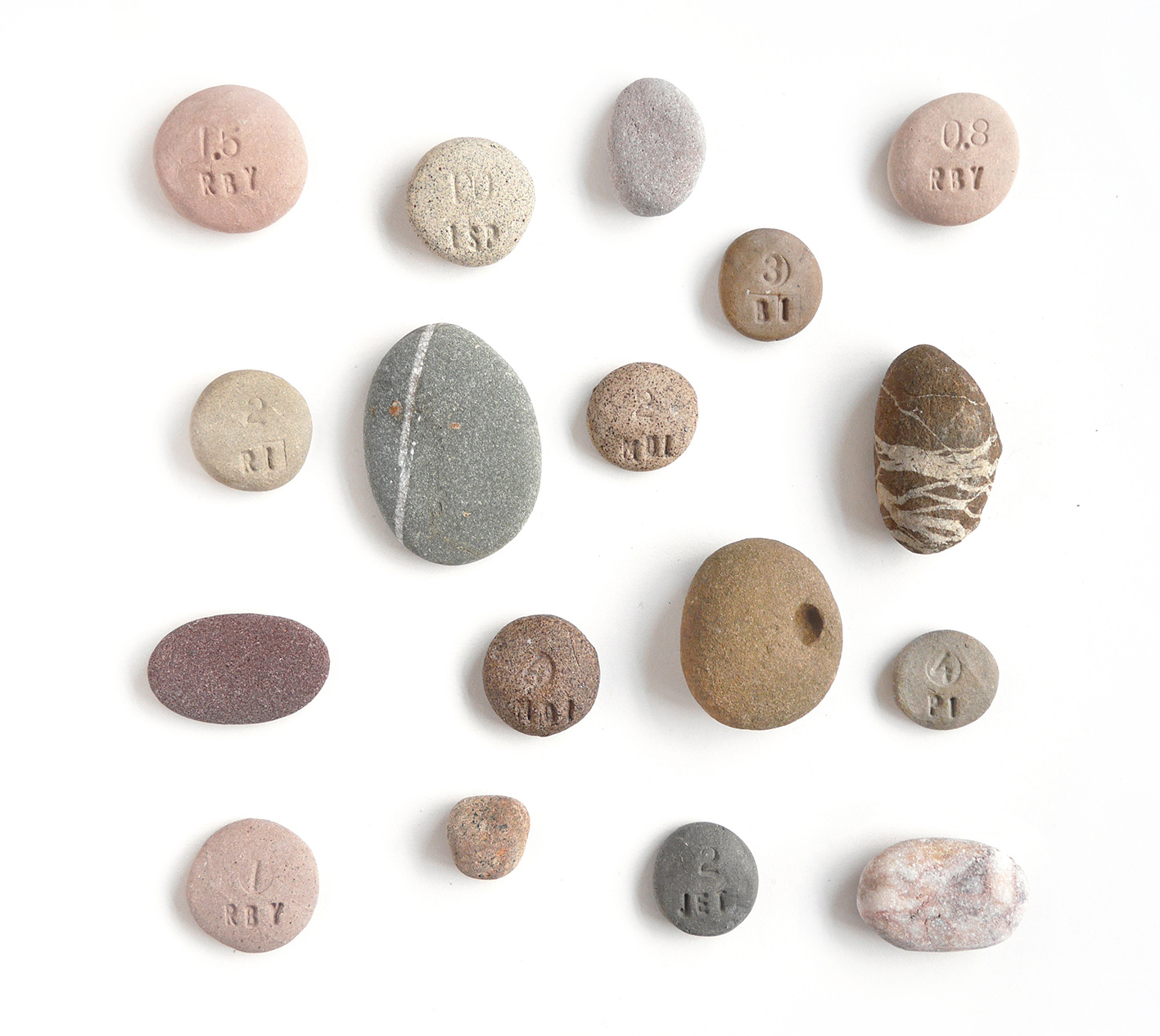 Collected pebbles and a few of my coloured clay body tests for rock and pebble pots