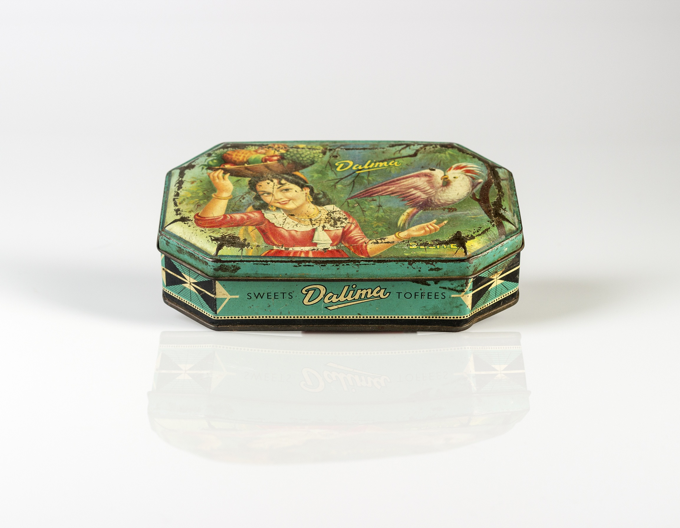 Her vintage Dalima Toffees and Sweets (girl with a fruit basket and Parrot Print Litho) tin box, where she keeps Her precious photo negatives and photographs  (Contents of her bedside drawer series),2016,Pure pigment print on Platine Rag paper, 35.5 x 45.75 cm