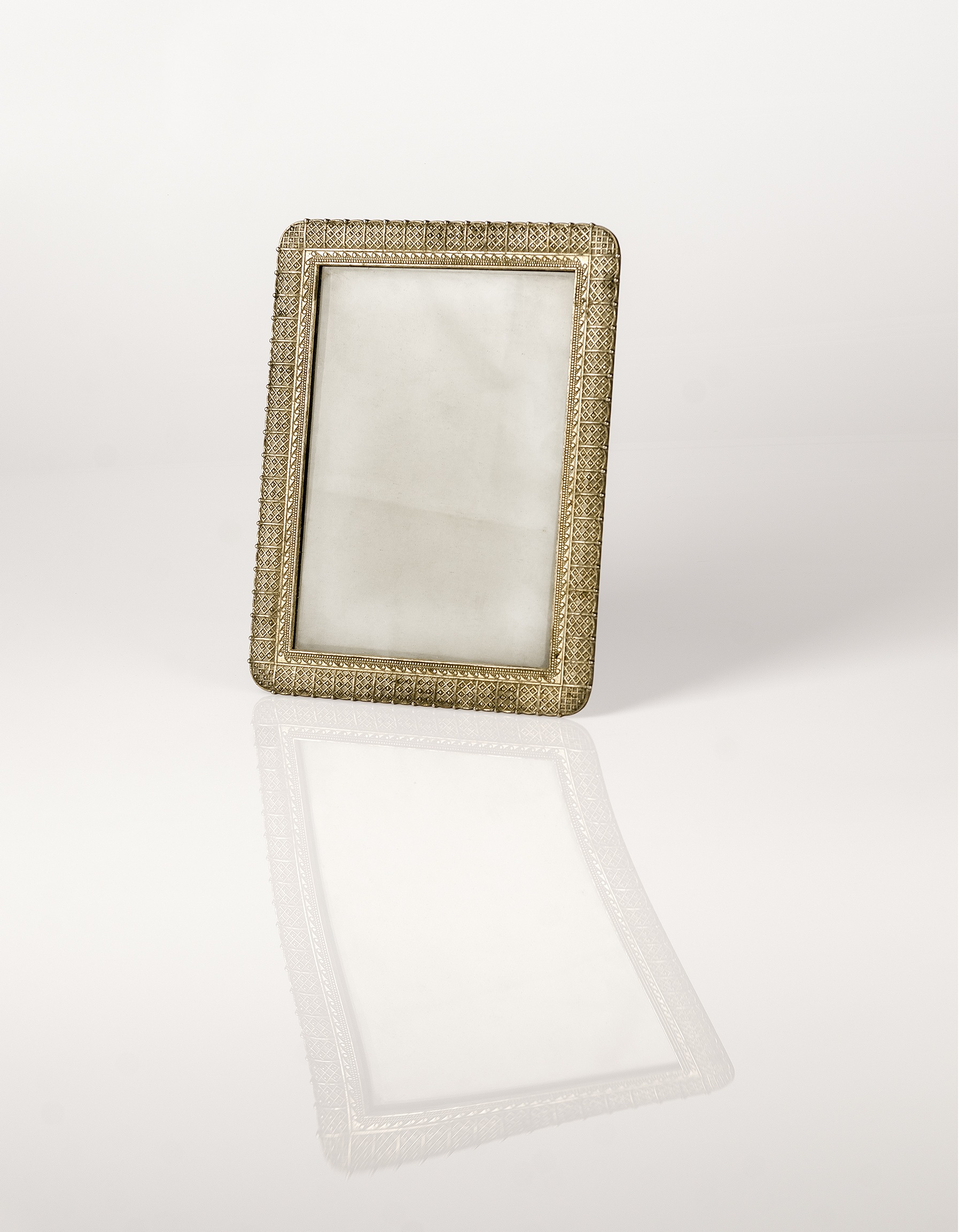 Her broken antique ornate silver frame where she once displayed her own or husband's old black and white photograph  (Contents of her bedside drawer series),2016