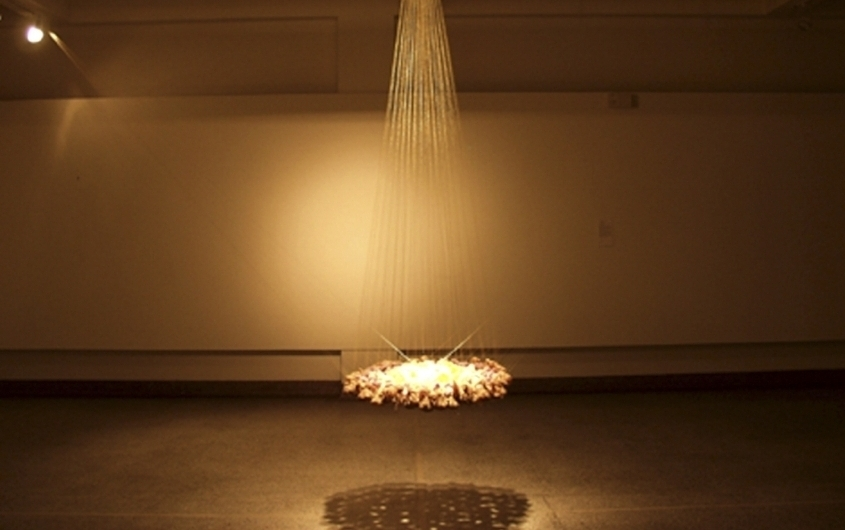 Discourse within Discourse: The Circle,  2003, Seven spices, spice dyed cheese cloth, gold zardozi thread and gold leaf, dimensions variable