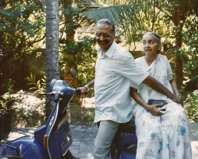 The author's uncle on his Vespa with one of his younger sisters