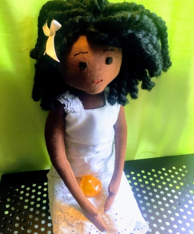 This custom doll by Jacqueline Bryant Campbell wears a dress made from the author's daughter's baptismal gown.