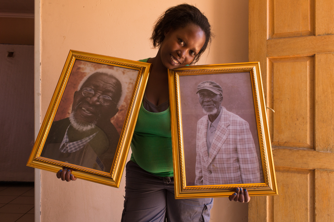 Jabulile Dibe (28), holding the two portraits her grandfather and I made.