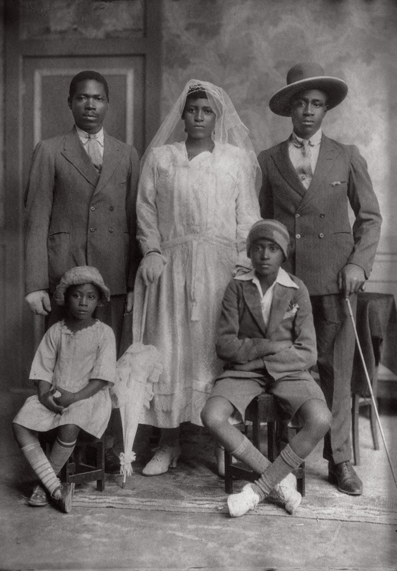 The wedding portrait of Mr. Pudumo's maternal great-grandparents, Samuel Tlale Nkone (left) and Rosta Nobelungu Nkone. Great-grandfather Samuel was a prison warden, Gran Rosta a domestic worker.