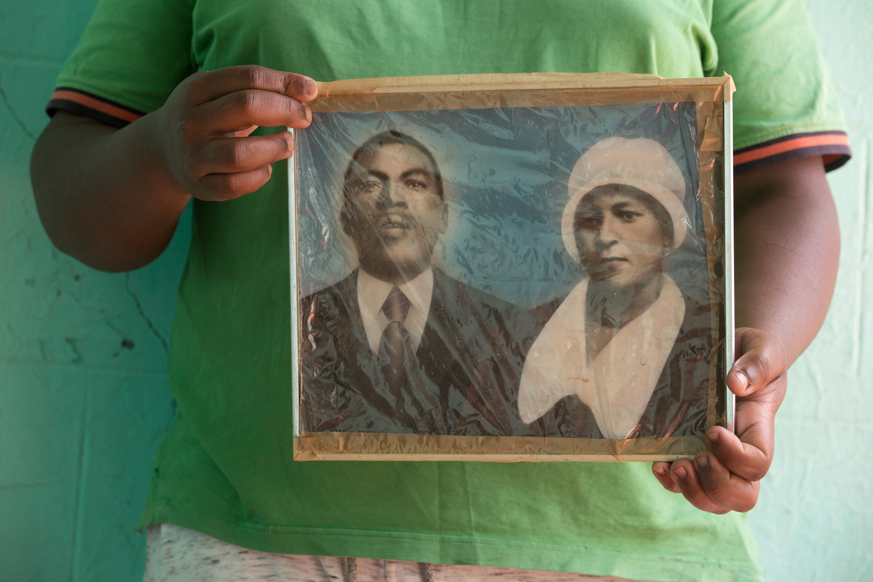 Plastic-wrapped, hand-coloured black-and-white photograph of the great-grandparents, Samuel Tlale Nkone and Rosta Nobelungu Nkone.