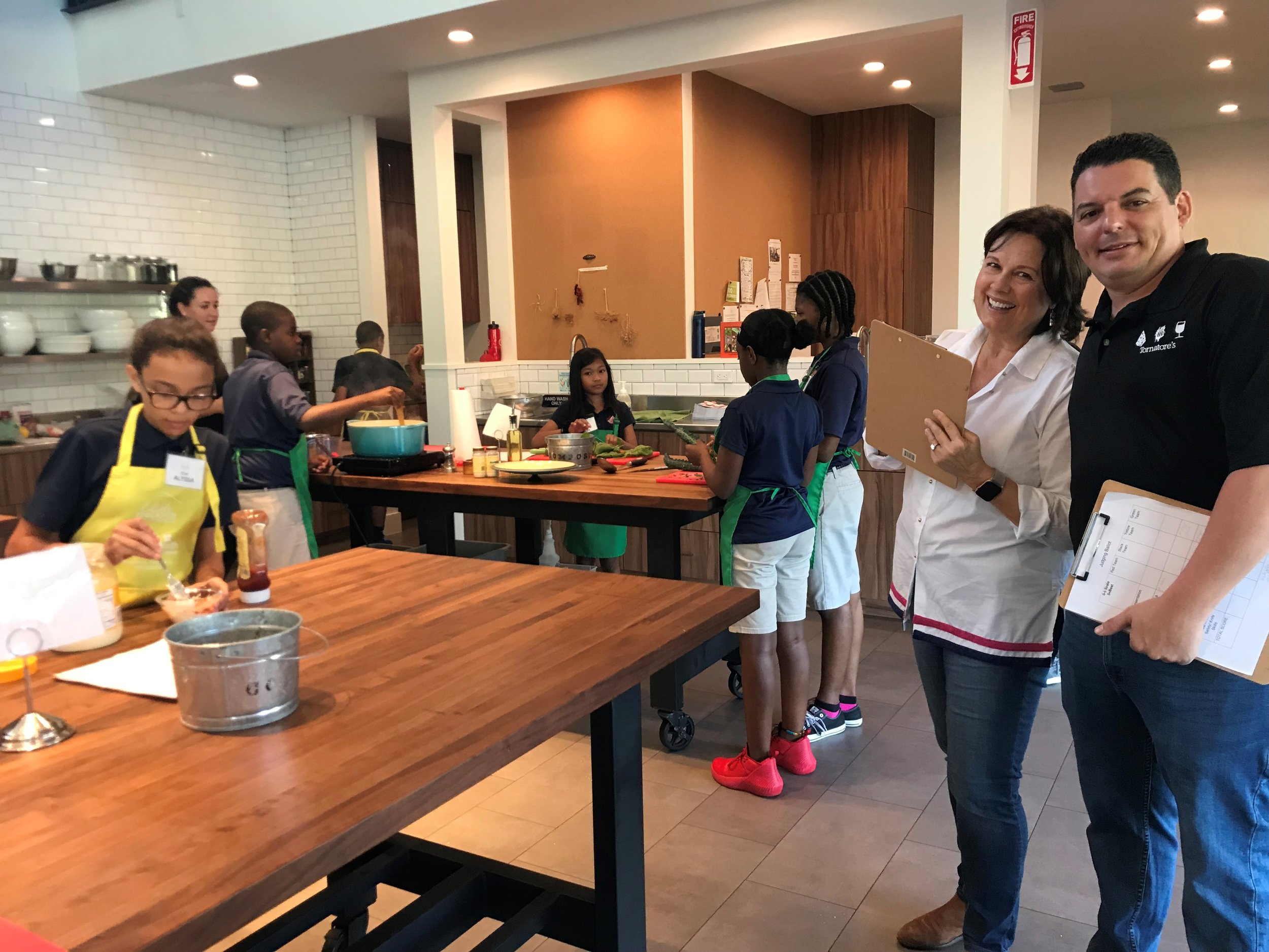 Junior chefs and judges at work in the Emeril Lagasse Foundation Kitchen House & Culinary Garden