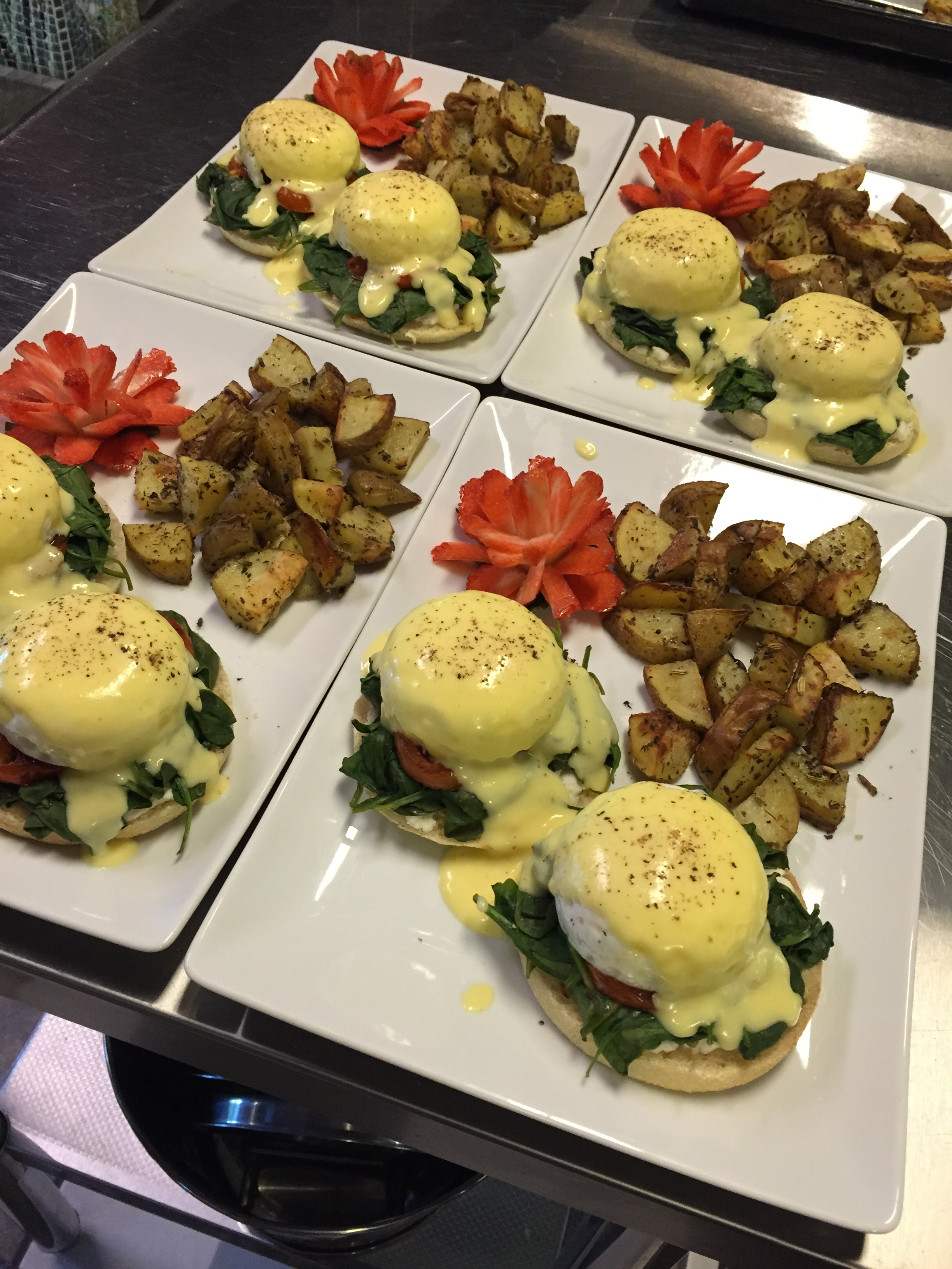 Our classically-prepared Eggs Florentine with bistro-style seasoned potatoes and a strawberry rose.
