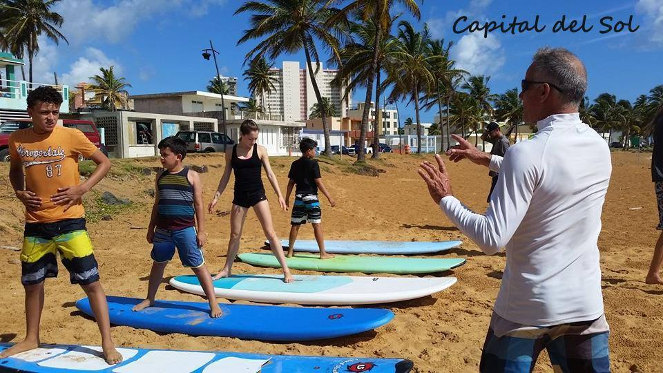 Bob gives directions on land before setting his surfers free in the water