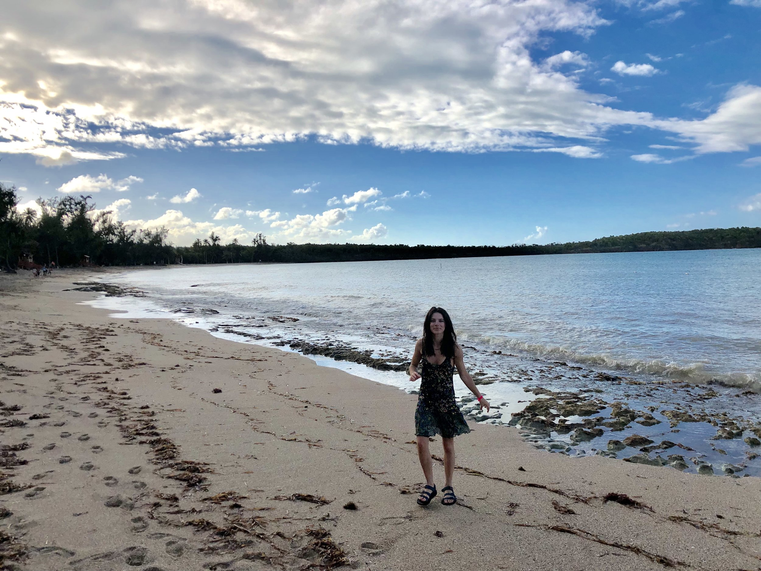 Photo of me at Seven Seas Bech, taken by Bill! That strip of trees in the background conceals the trail you'll take out to Escondida (or… maybe…Colorá? (-; )