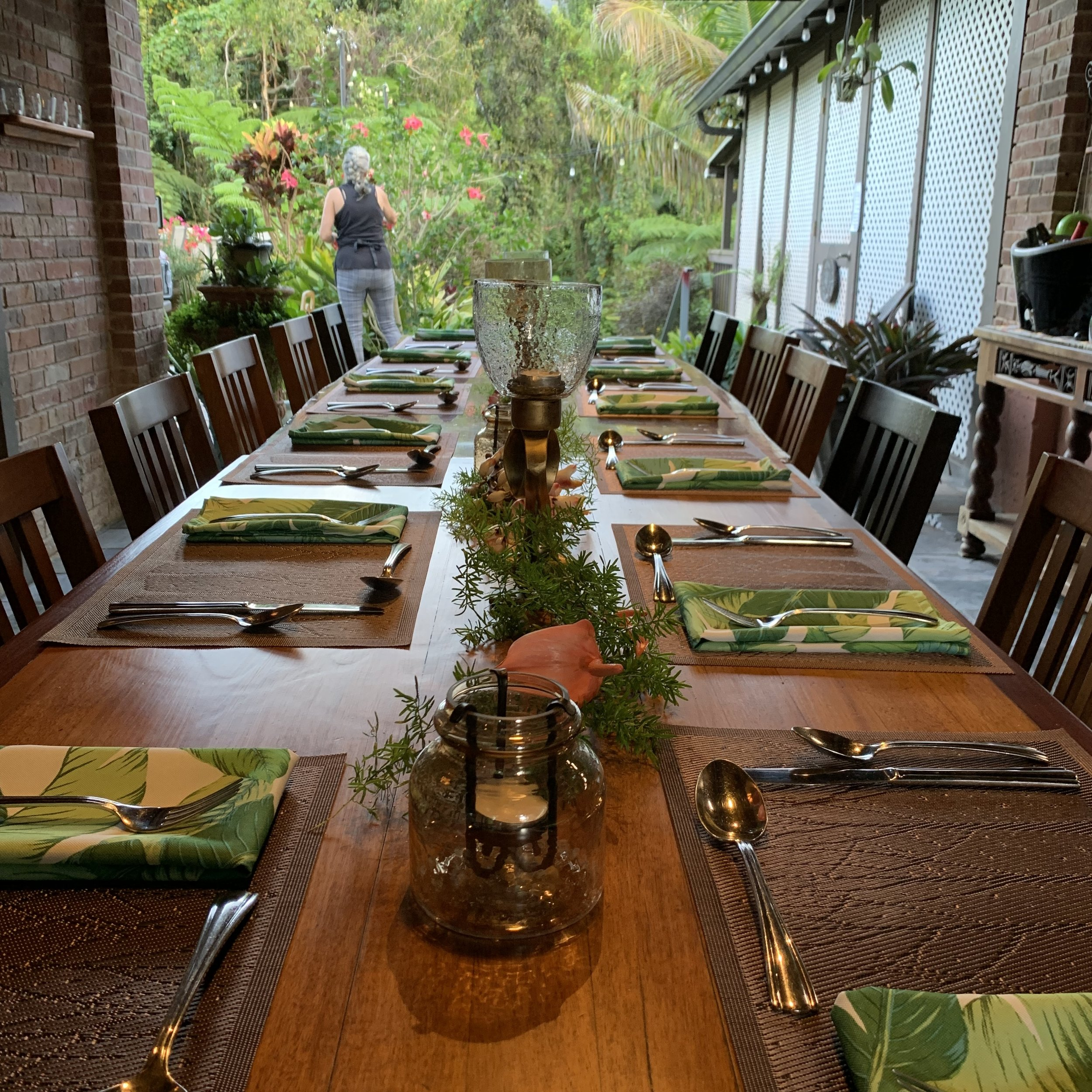 Like many of the ingredients in the meal, the table decorations also came from the property. You can see Renée picking Hibiscus in the background. And what a lovely view for a dinner party!
