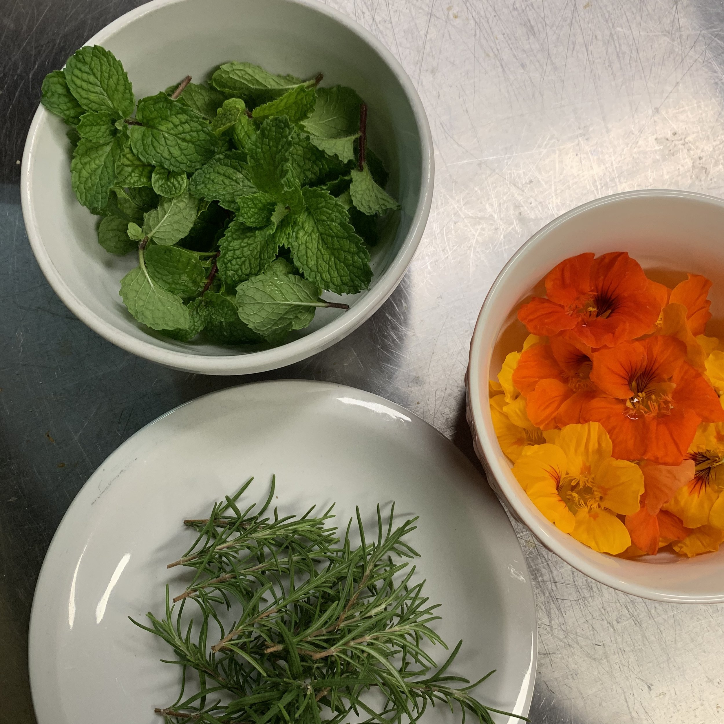 Mint for the water, rosemary for the potatoes, and edible flowers for dessert. And they all came right off the Inn's property!