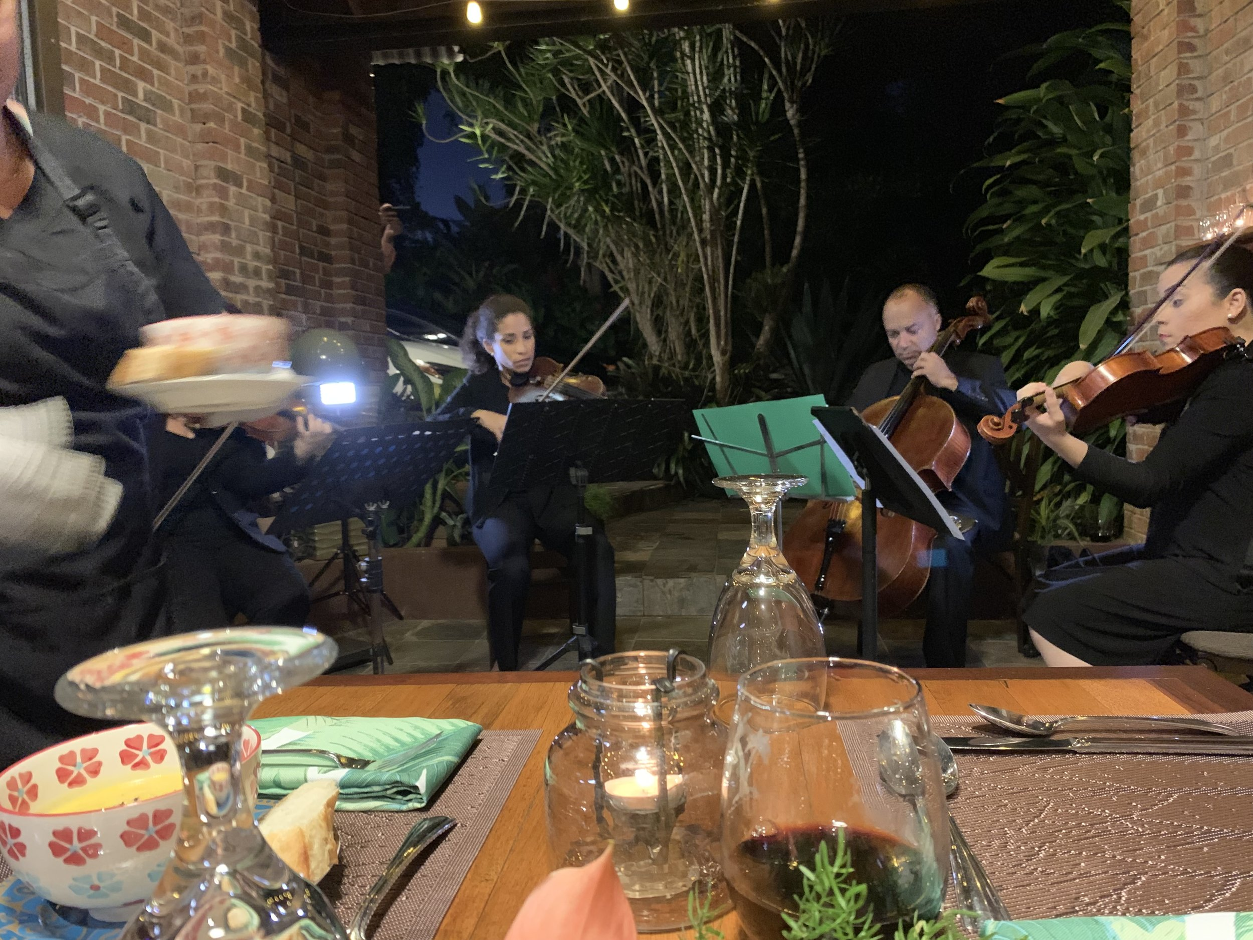 The quartet plays away as the first course is served.