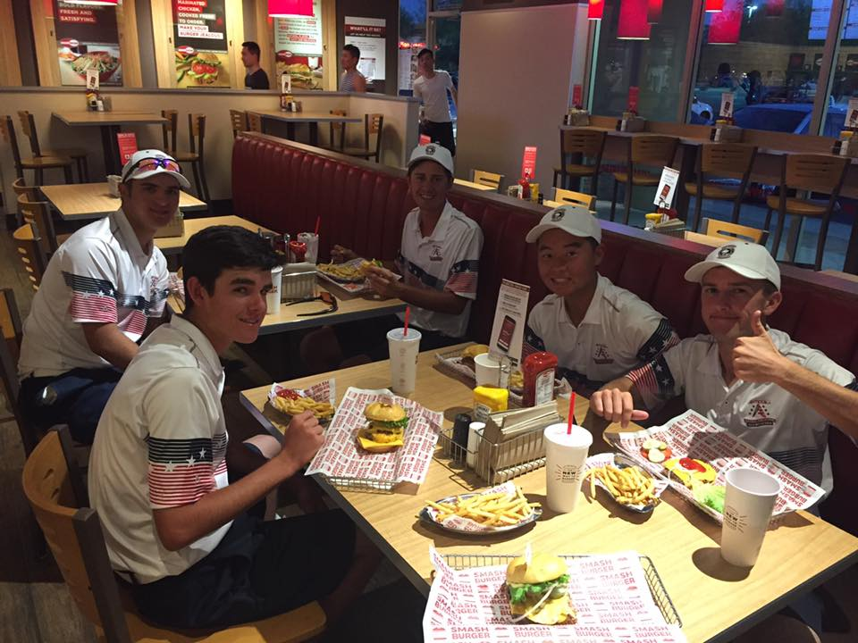The Hamilton Huskies Boys Golf Team continued its drive towards the state tournament with a match win at the challenging Alta Mesa CC against Mt. View/Queen Creek and Sunnyslope. The team was led to victory by sophomore Ethan Adam, senior Nick Hedman and TJ Reitano, juniors Alexander Yu and Brandon Hill. Here is a picture of the team enjoying a post match meal.