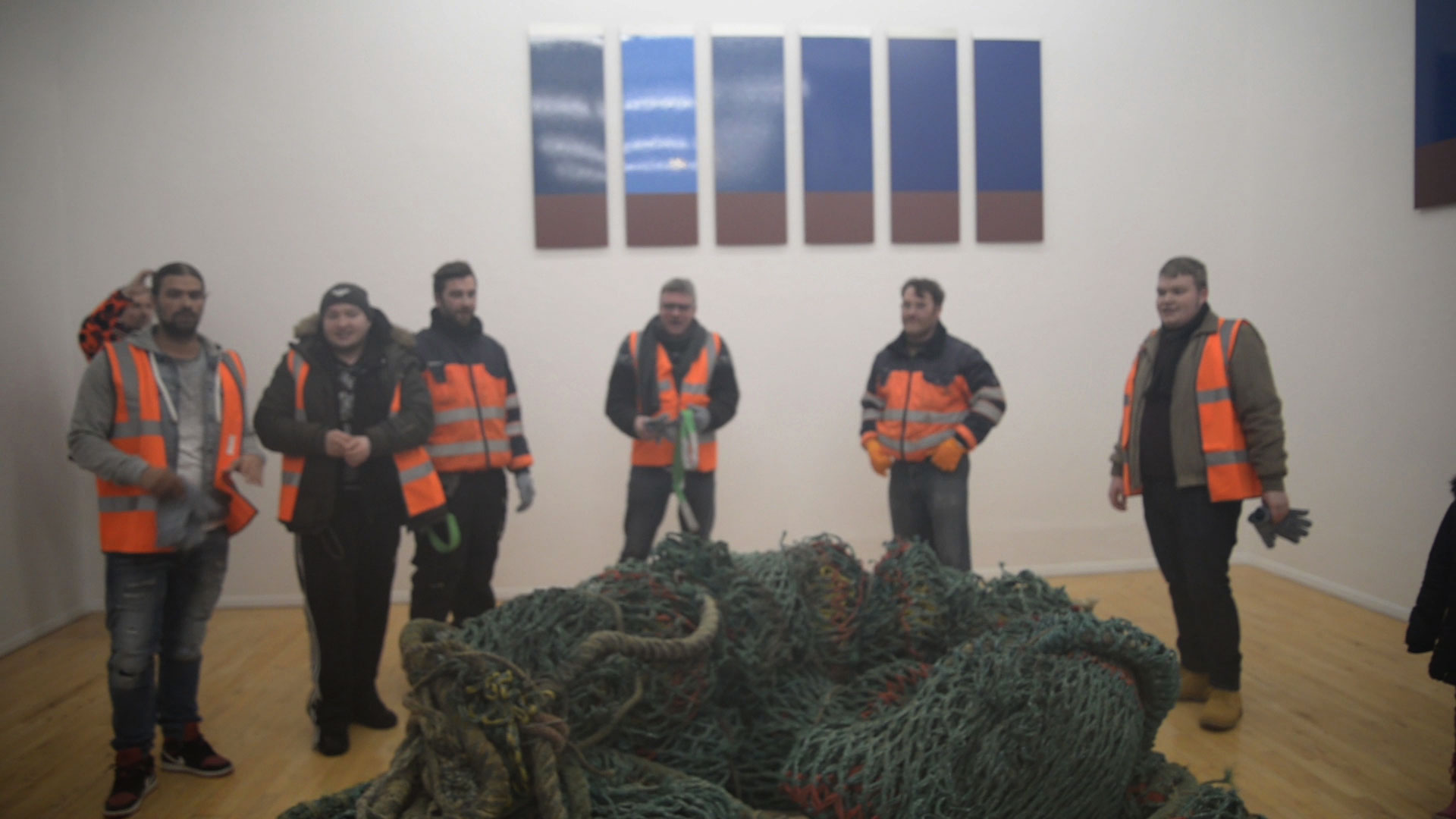 Still from video documentation of dock worker performance.