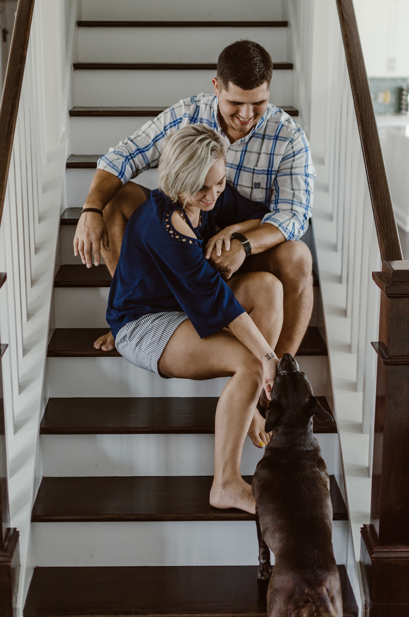 intimate couples portaits on stairs with dog wilmington nc
