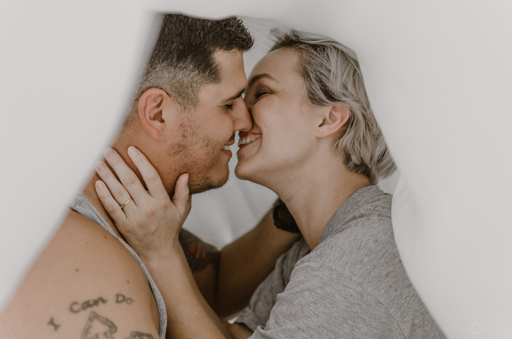 intimate in home couples portrait session under the sheets kissing boudoir wilmington nc