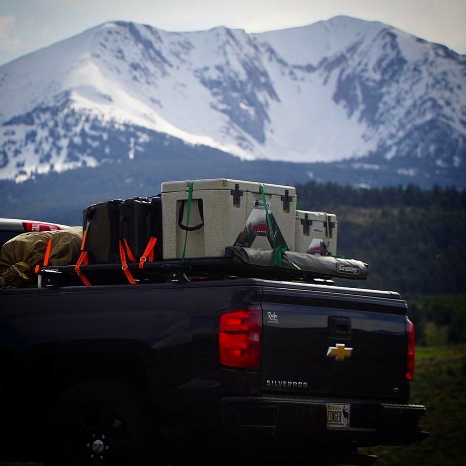 Lifestyle photo of Alpha Pro Series Coolers in the back of a truck