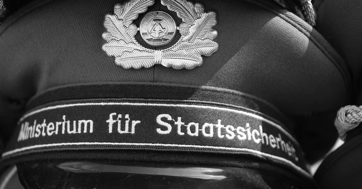 Stasi troops indicated their belonging on their hats. The entire country was afraid of that line of text.