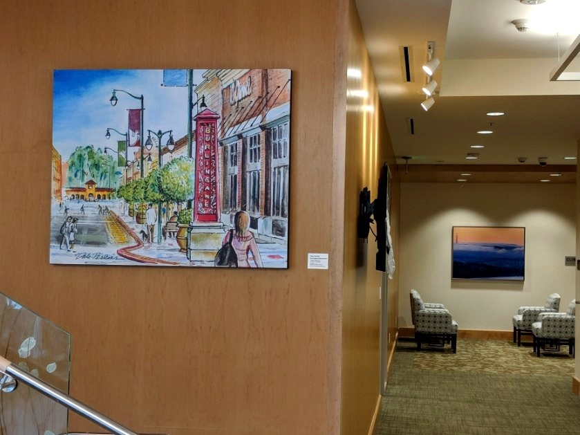 Local watercolor artist Dale Perkins paints a scene of downtown Burlingame for one of our senior living facilities where the building is located.