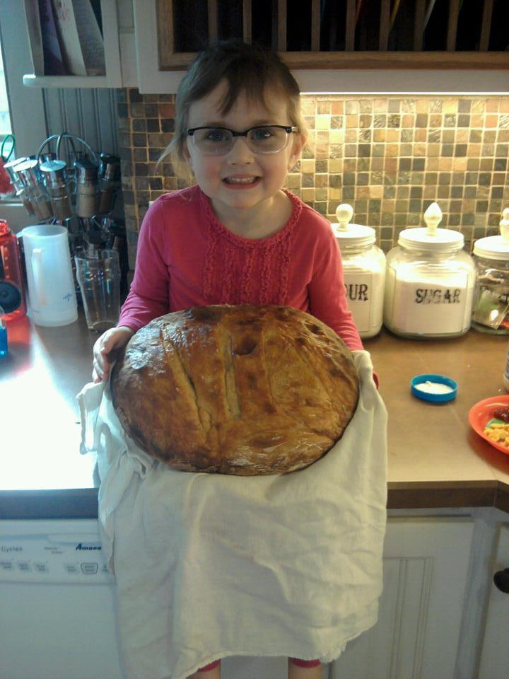 Eleanor and our first bread loaf using the artisan bread making technique. Now that's a big loaf of bread!