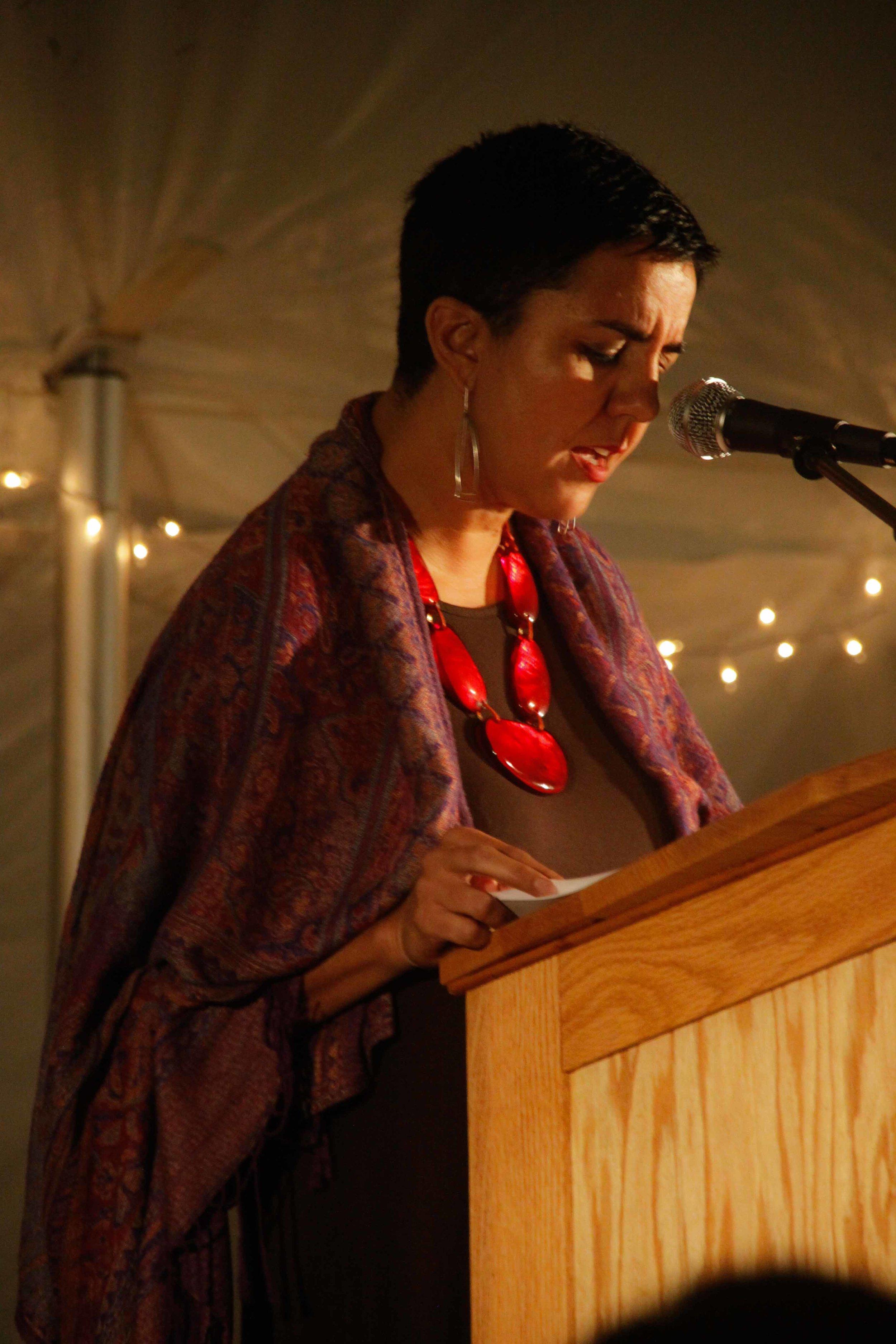 "Carmen Giménez Smith reads her poem ""Be Recorder"" (Photo courtesy of Justin Robert Cox)"