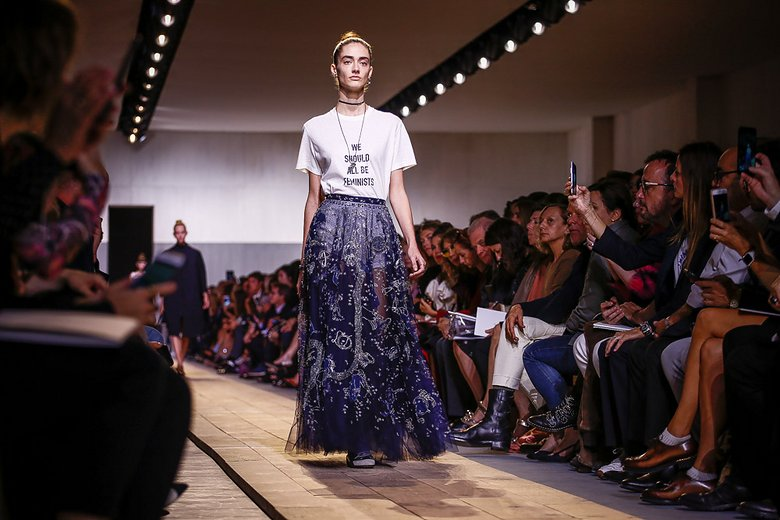 "Maria Grazia Chiuri's ""We should all be feminists"" graphic tee at Paris Fashion Week ( source )"