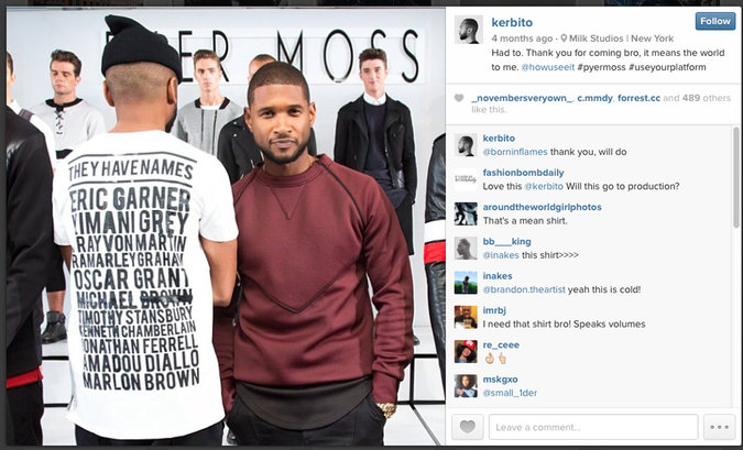"Kerby Jean-Raymond wearing his ""They Have Names"" graphic tee alongside Usher ( source )"