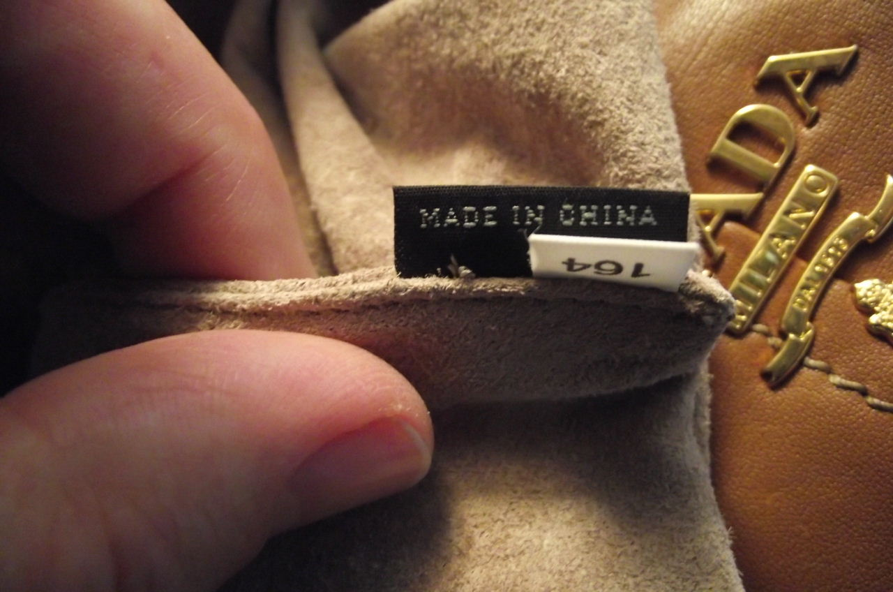 Evidence of Prada outsourcing their handbag production is hidden within the lining of the handbag