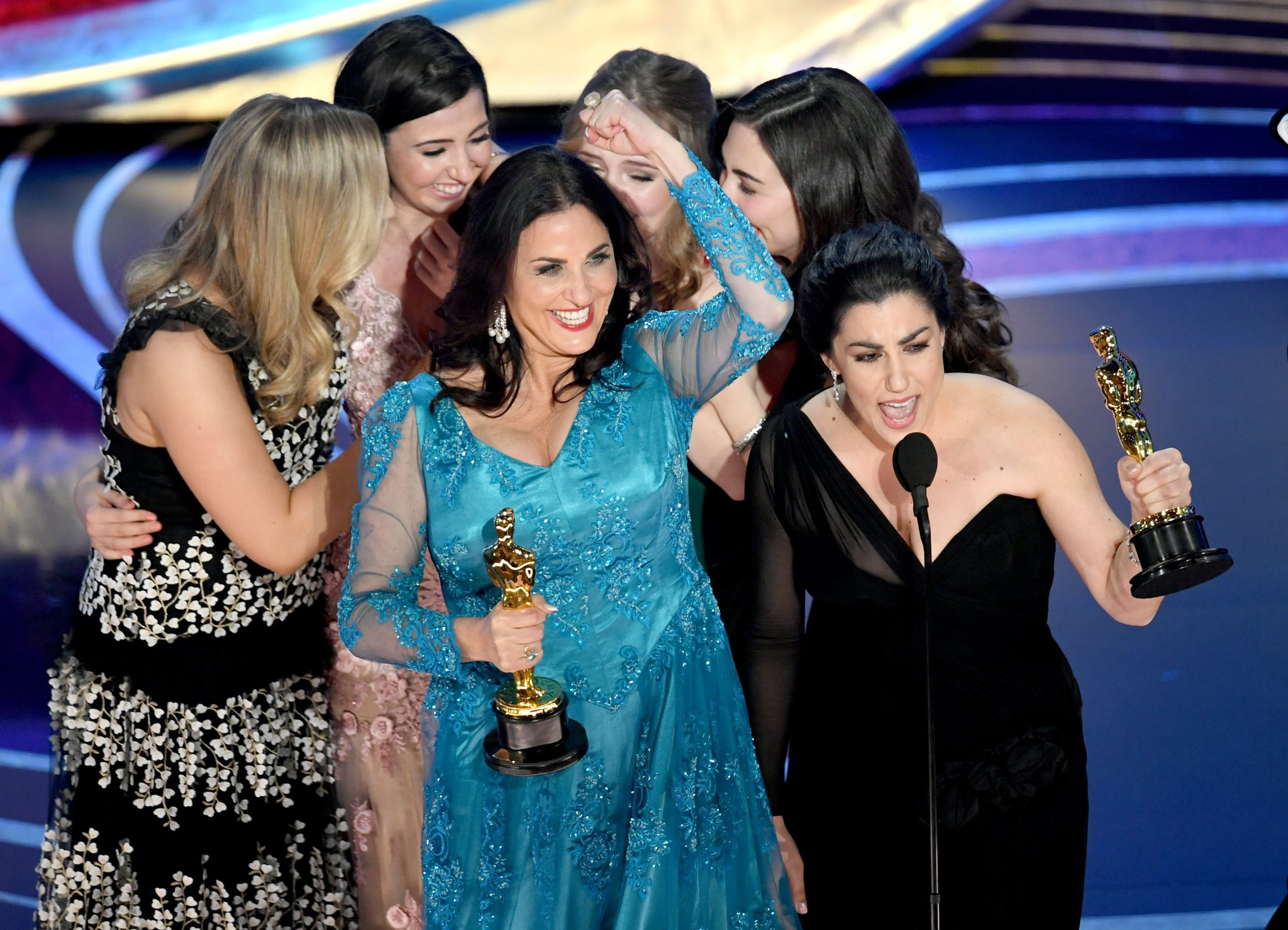 Producer Melissa Berton (Center) and Director Rayka Zehtabchi (Right) accepting the award last February.  Via Getty Images