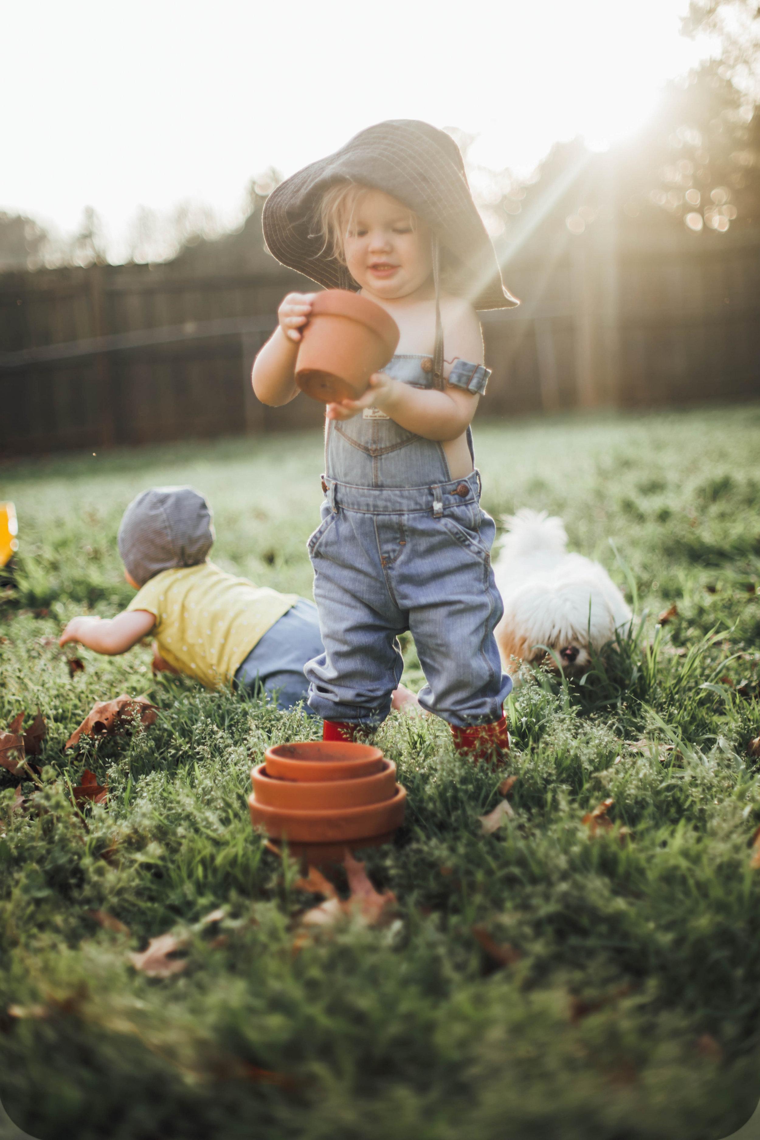 Kids in the garden, boy in a sun hat by Blue Corduroy