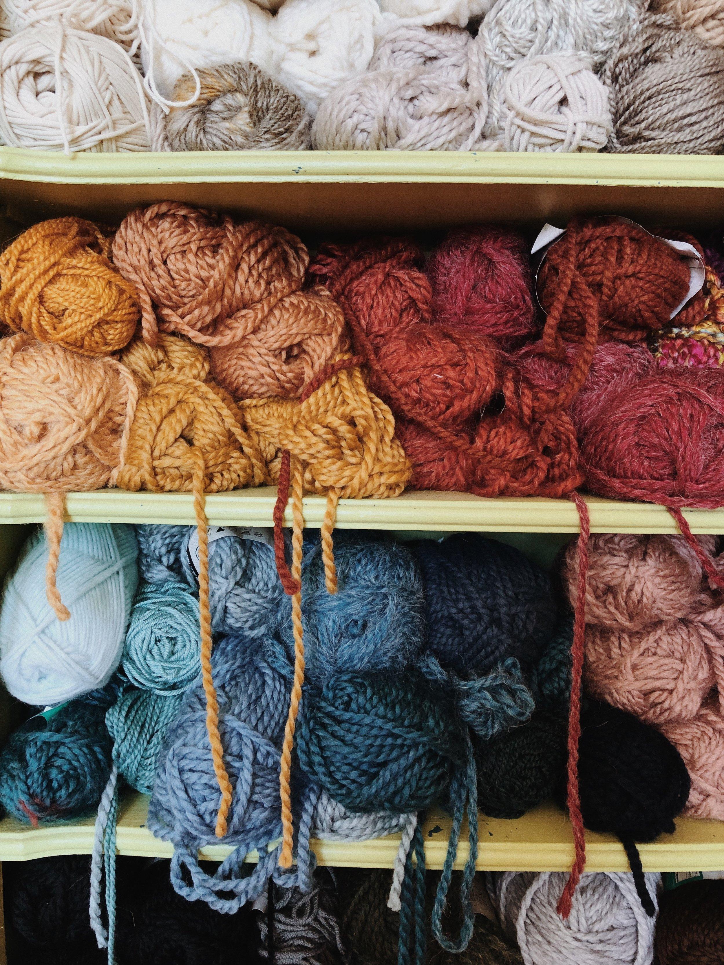 Colorful Yarn stash in my living room sewing studio.