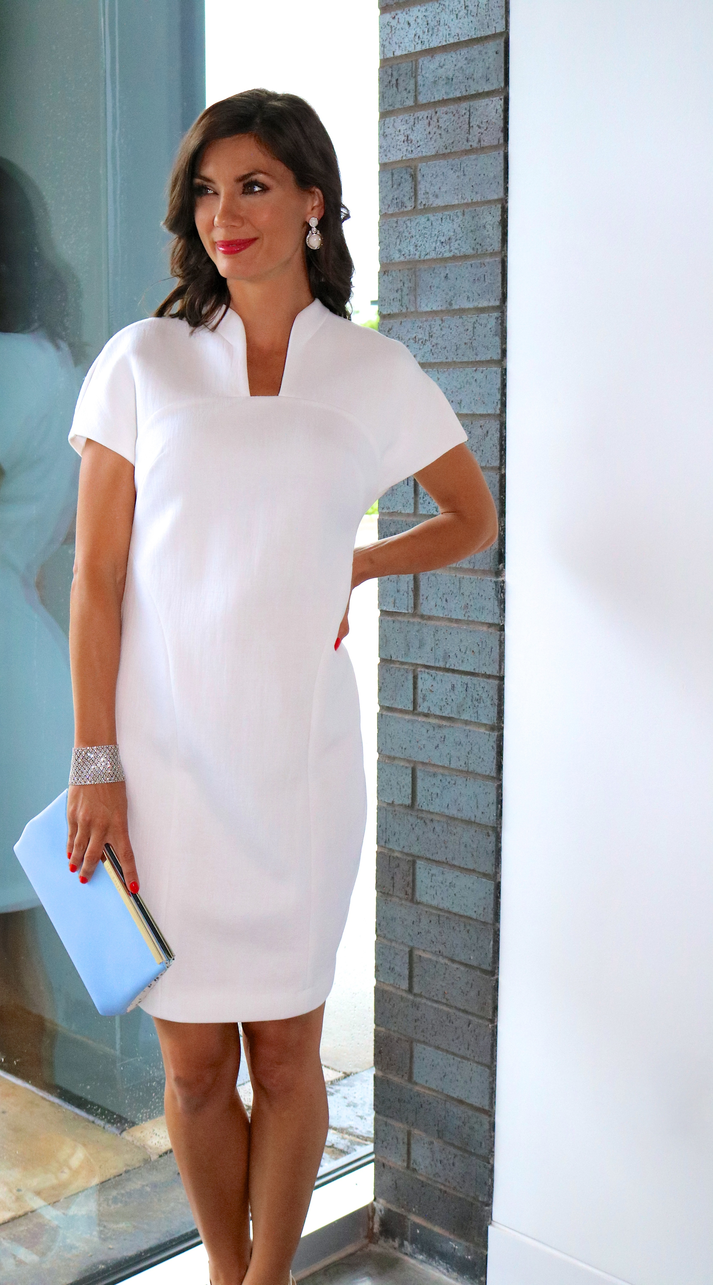 Karolina Zmarlak White Technical Cotton Rounded Shift and Ted Baker Exotic Clutchavailable in-store