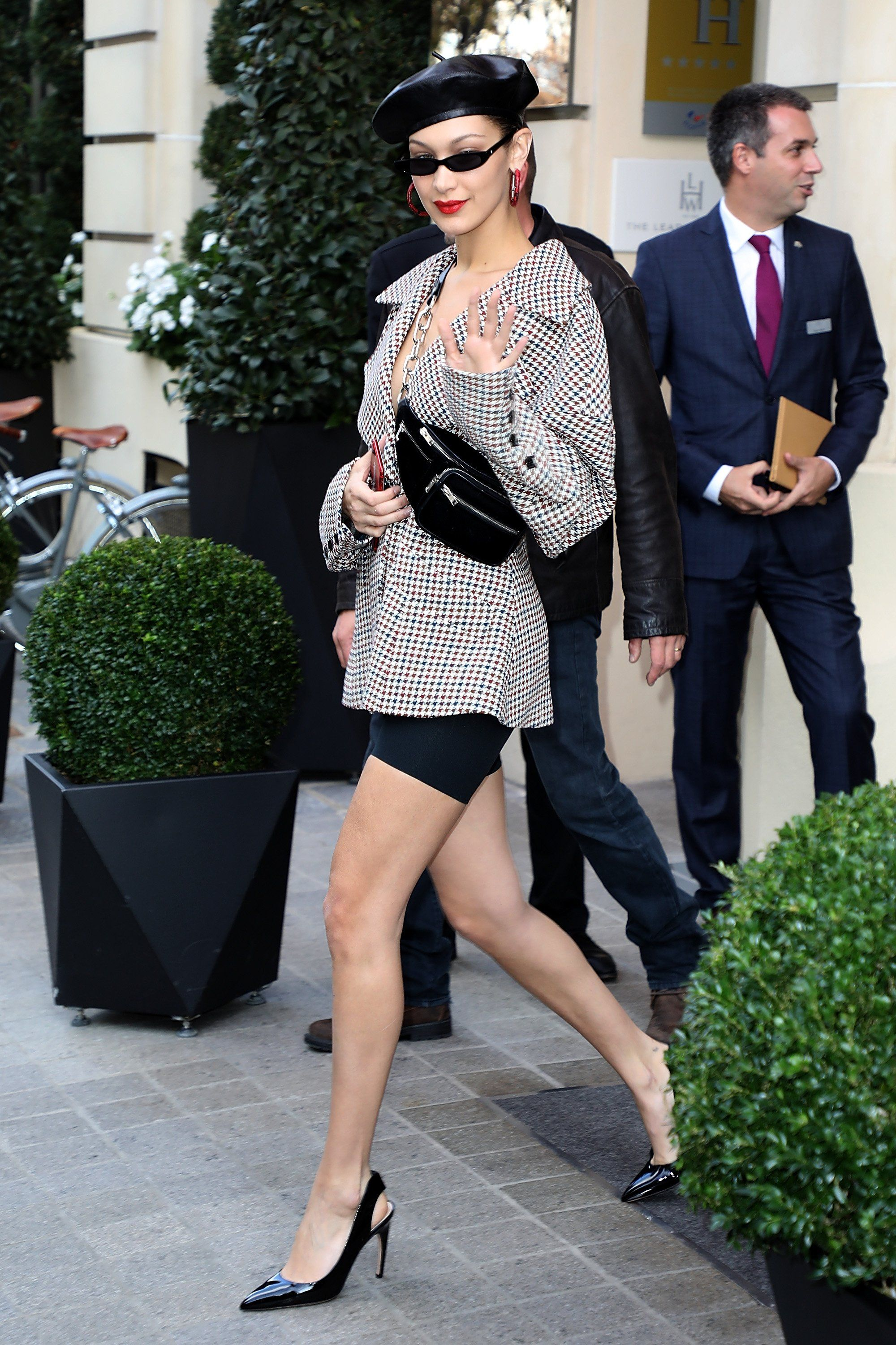 Bella Hadid stepped onto the streets of Paris in Commando classic control short, Claudia Li blazer, and sling-back pumps.