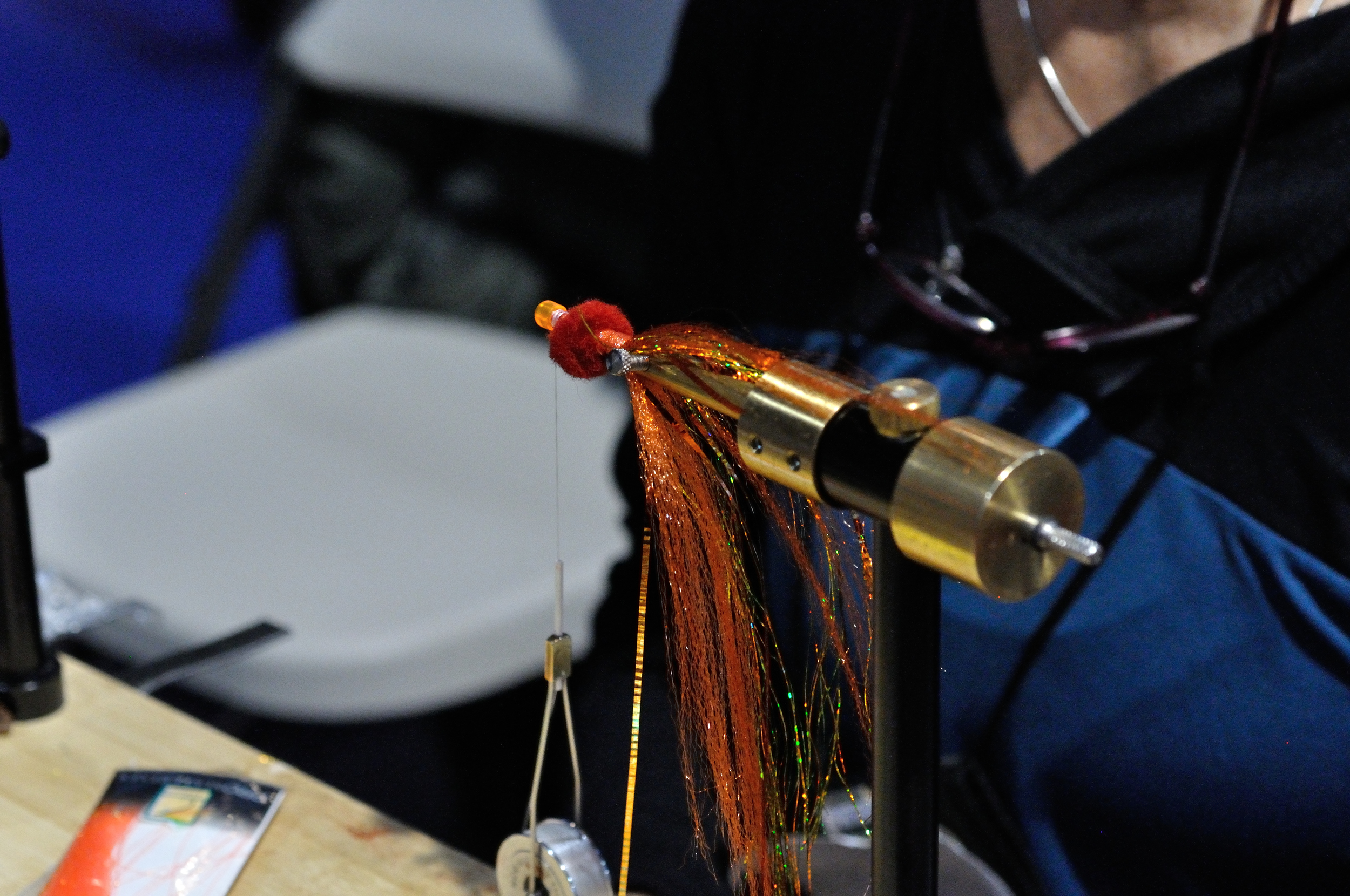 They were using craft egg balls as a means to flair materials around the hook.