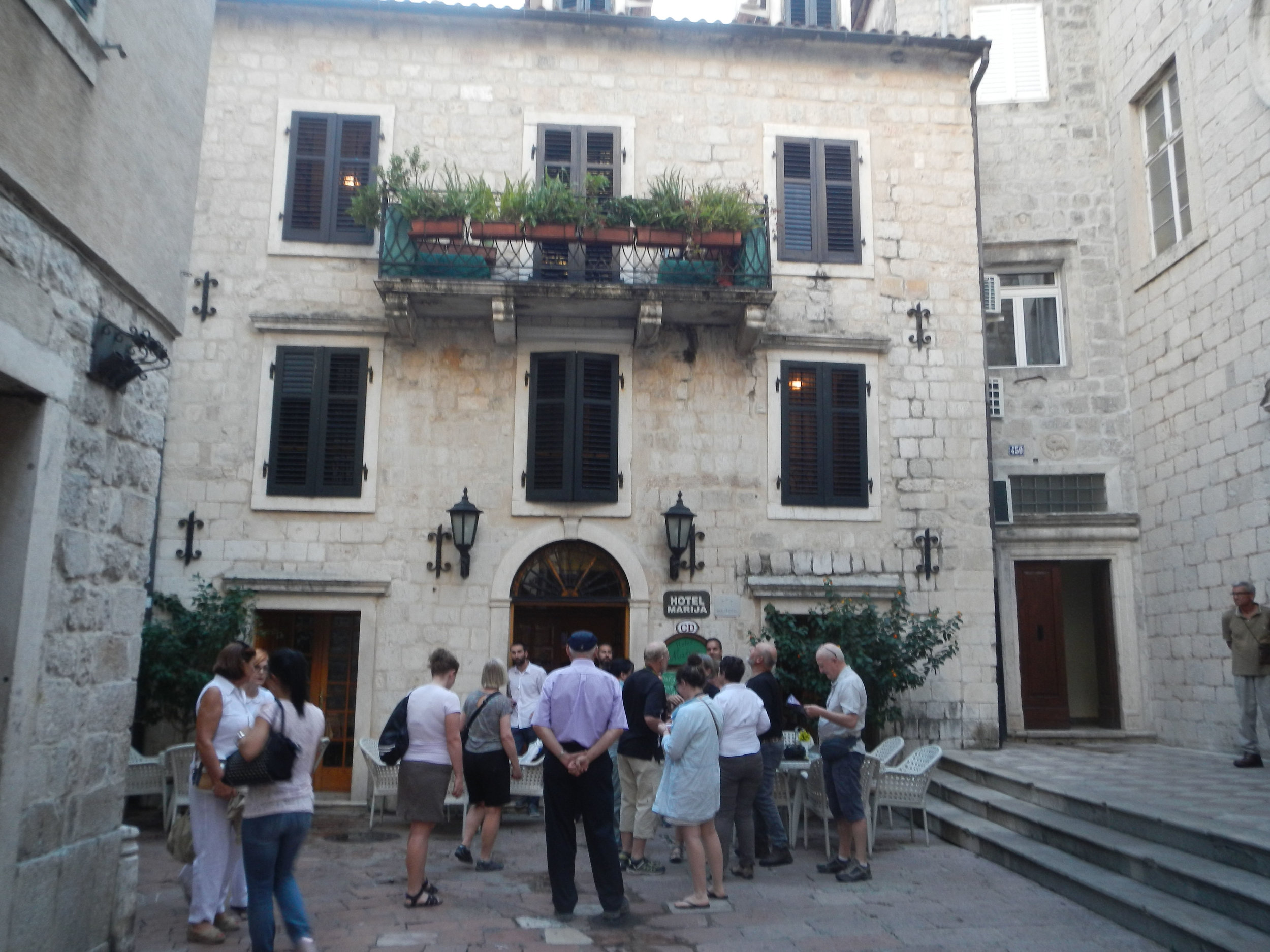 Group gathering outsife Hotel Majira (our room is the one with the balcony), Kotor, Montenegro
