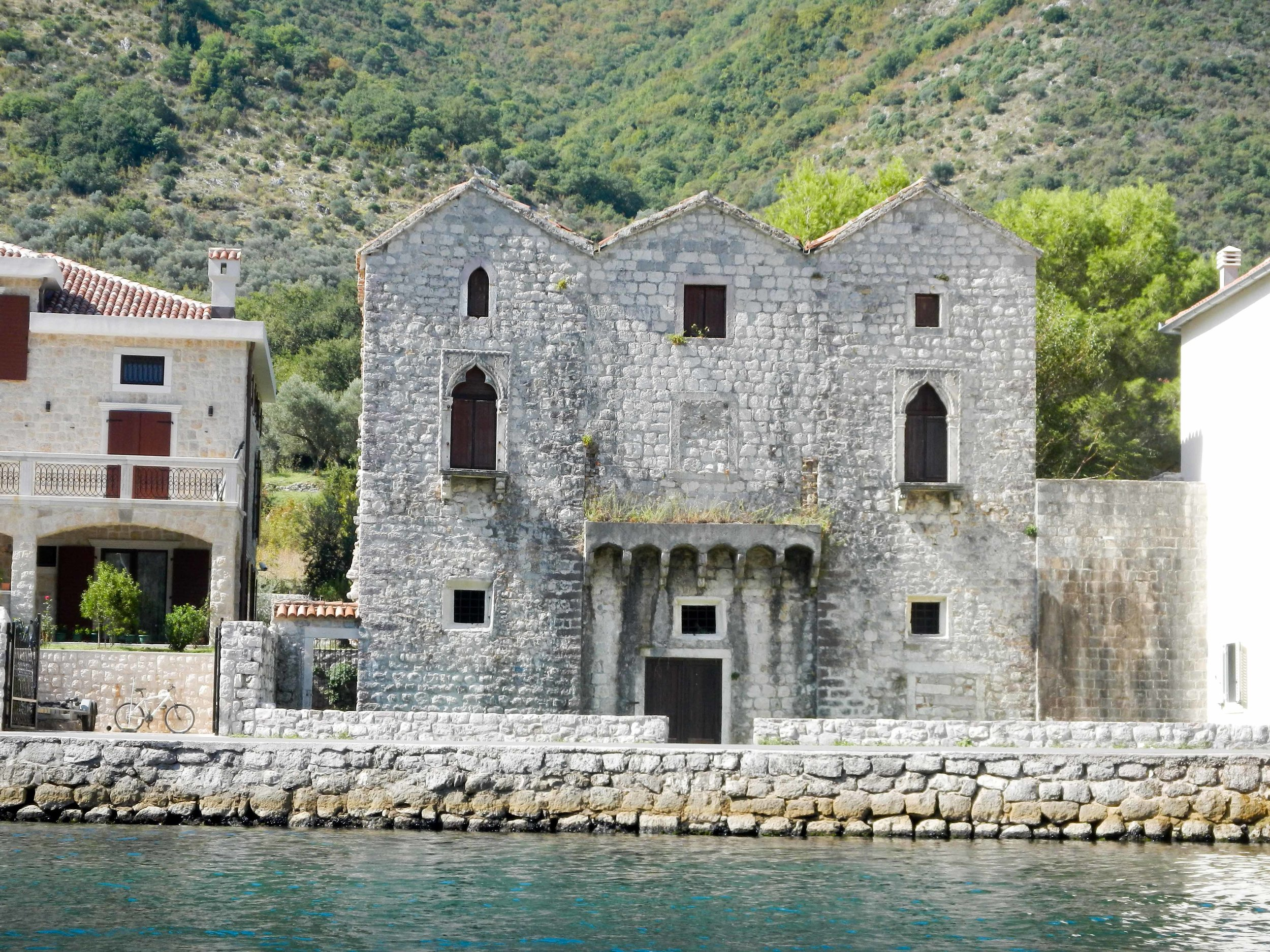 Old house from kayak, Kotor, Montenegro