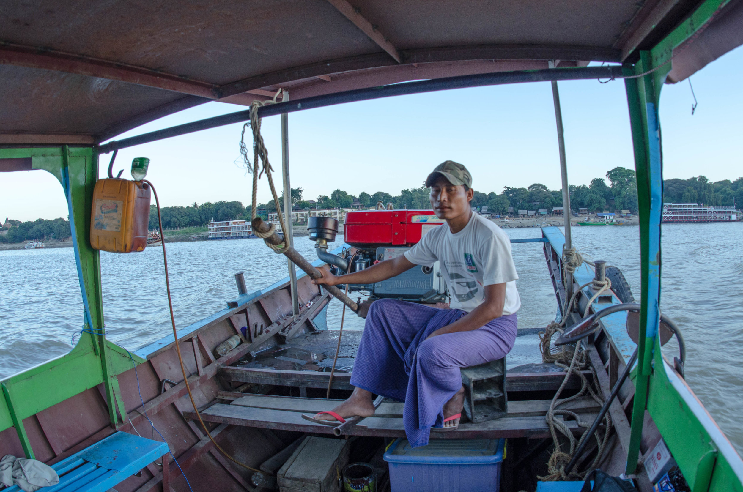 Our boatman, Irrawaddy River sunset cruise
