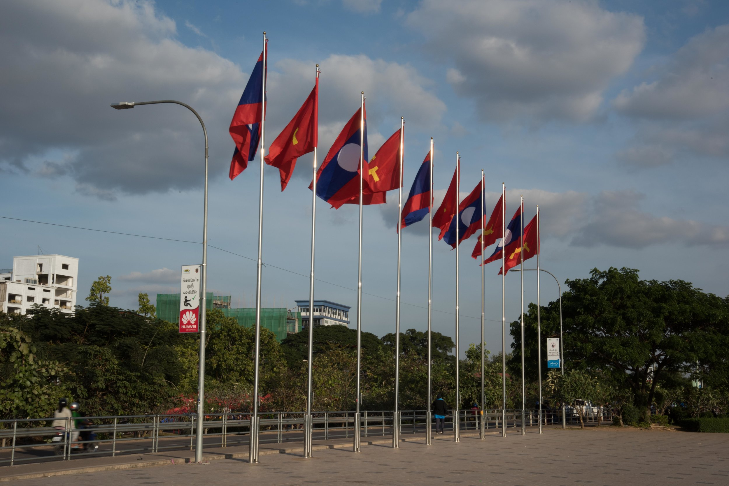 Flags, Vientiane, Laos, 27 Nov 2017.jpg