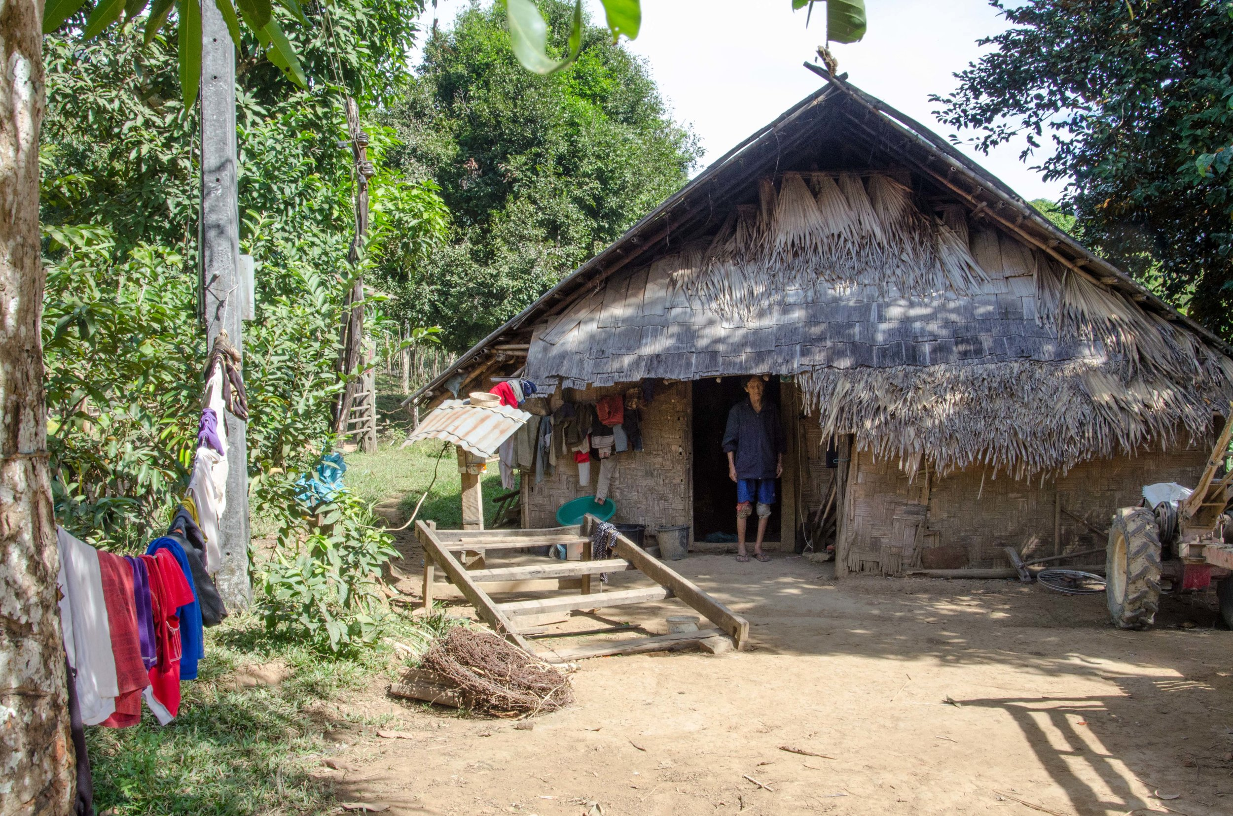 Hmong village house on route to Than Phu Kham, Vang Vieng, Laos, 29 Nov 2017.jpg
