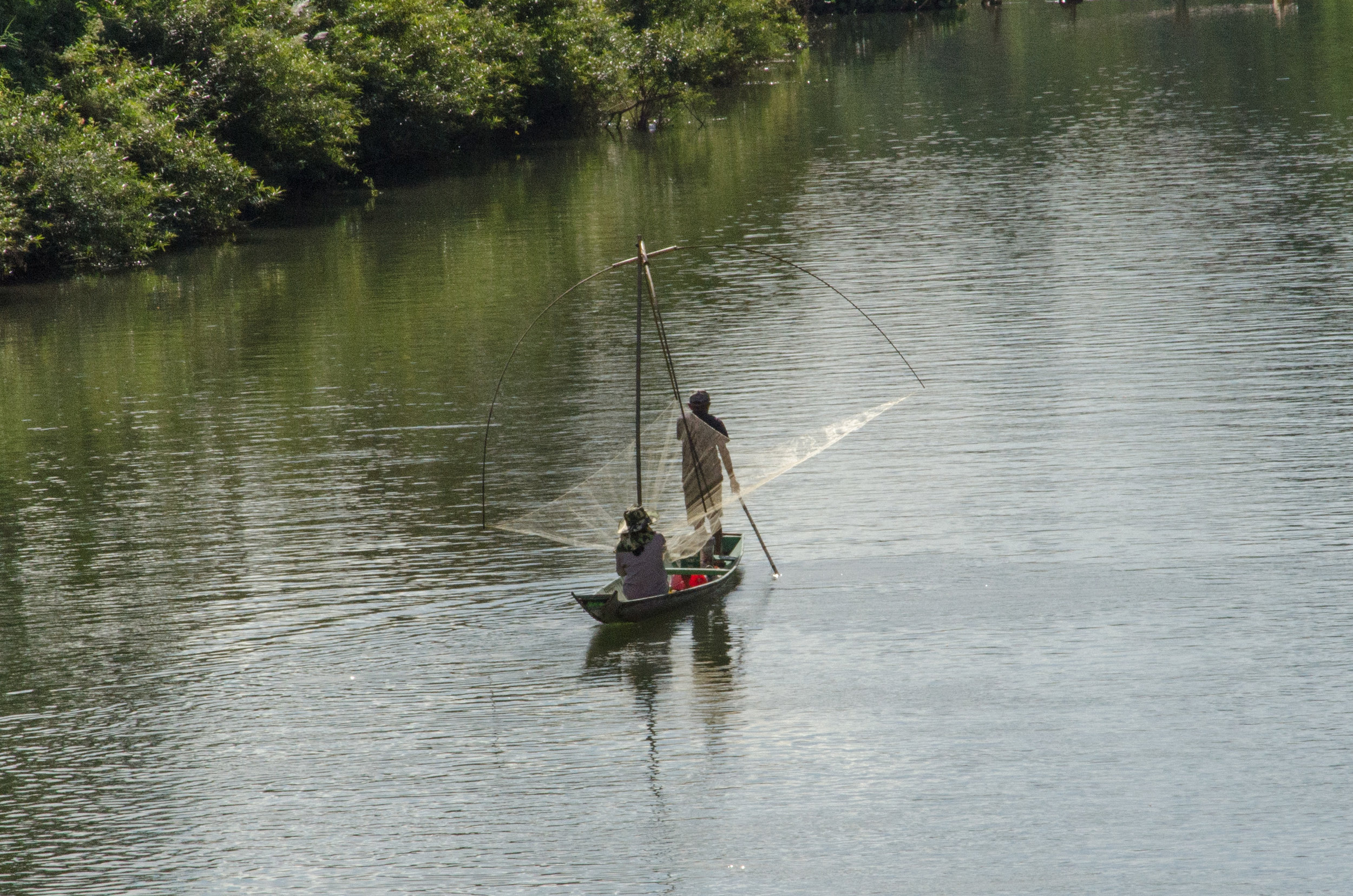 Fisherman, Nan Song River, Vang Vieng, Laos, 29 Nov 2017.jpg