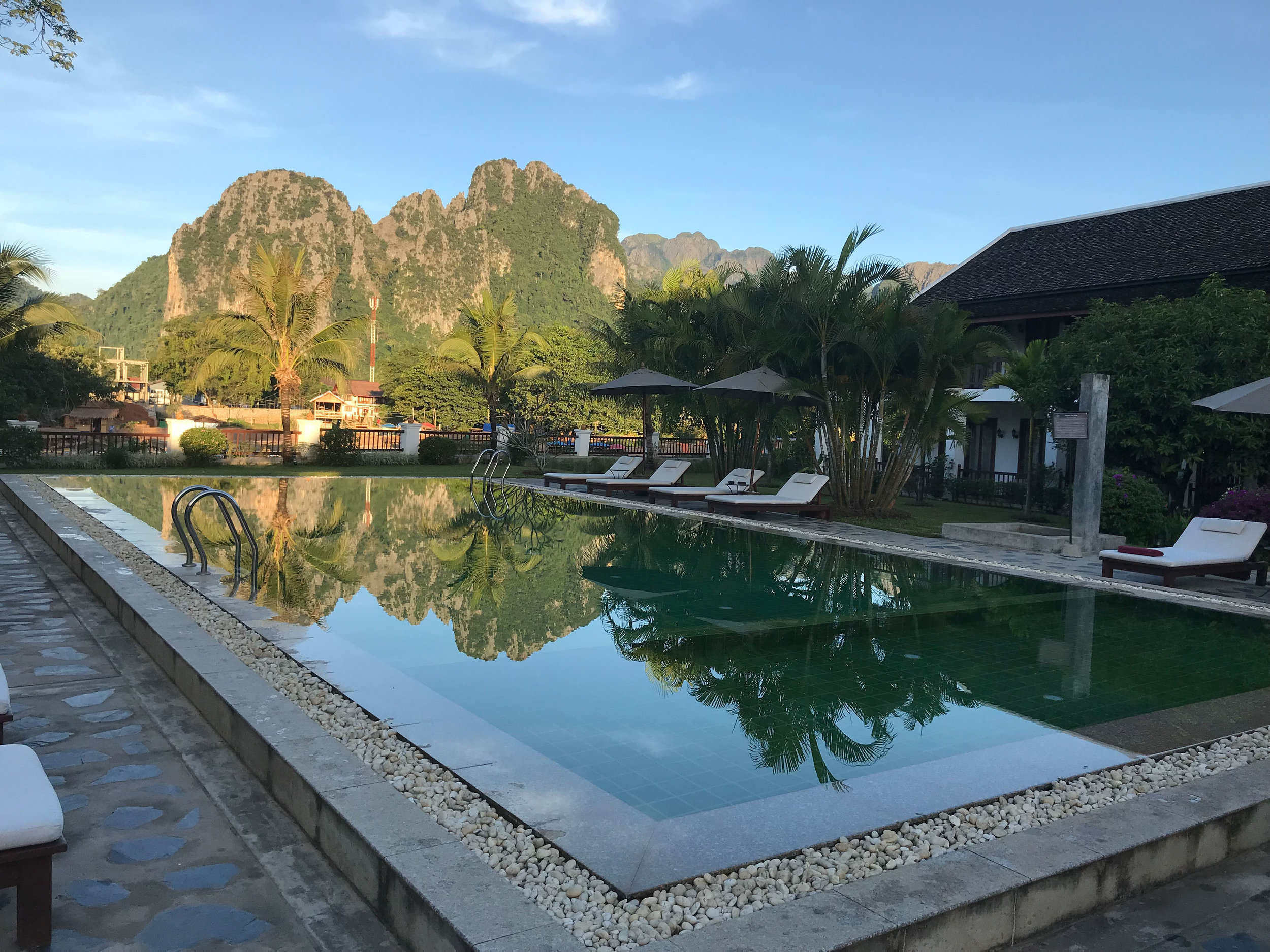 Karst mountains behind swimming pool, Riverside Boutique Resort, Vang Vieng, Laos, 30 Nov 2017.jpg